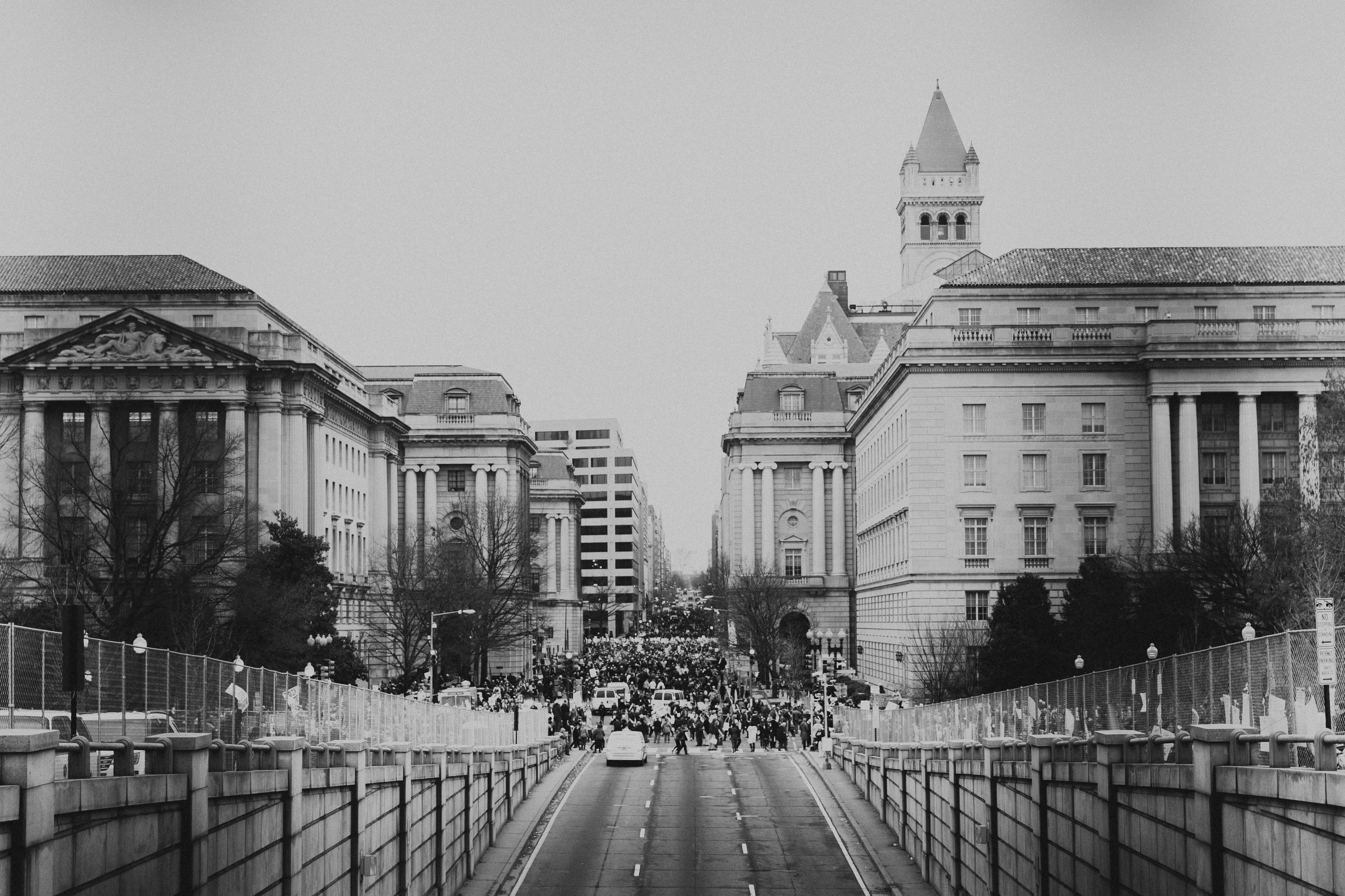 Black and white shot of feminist equality protest in street from distance in Washington