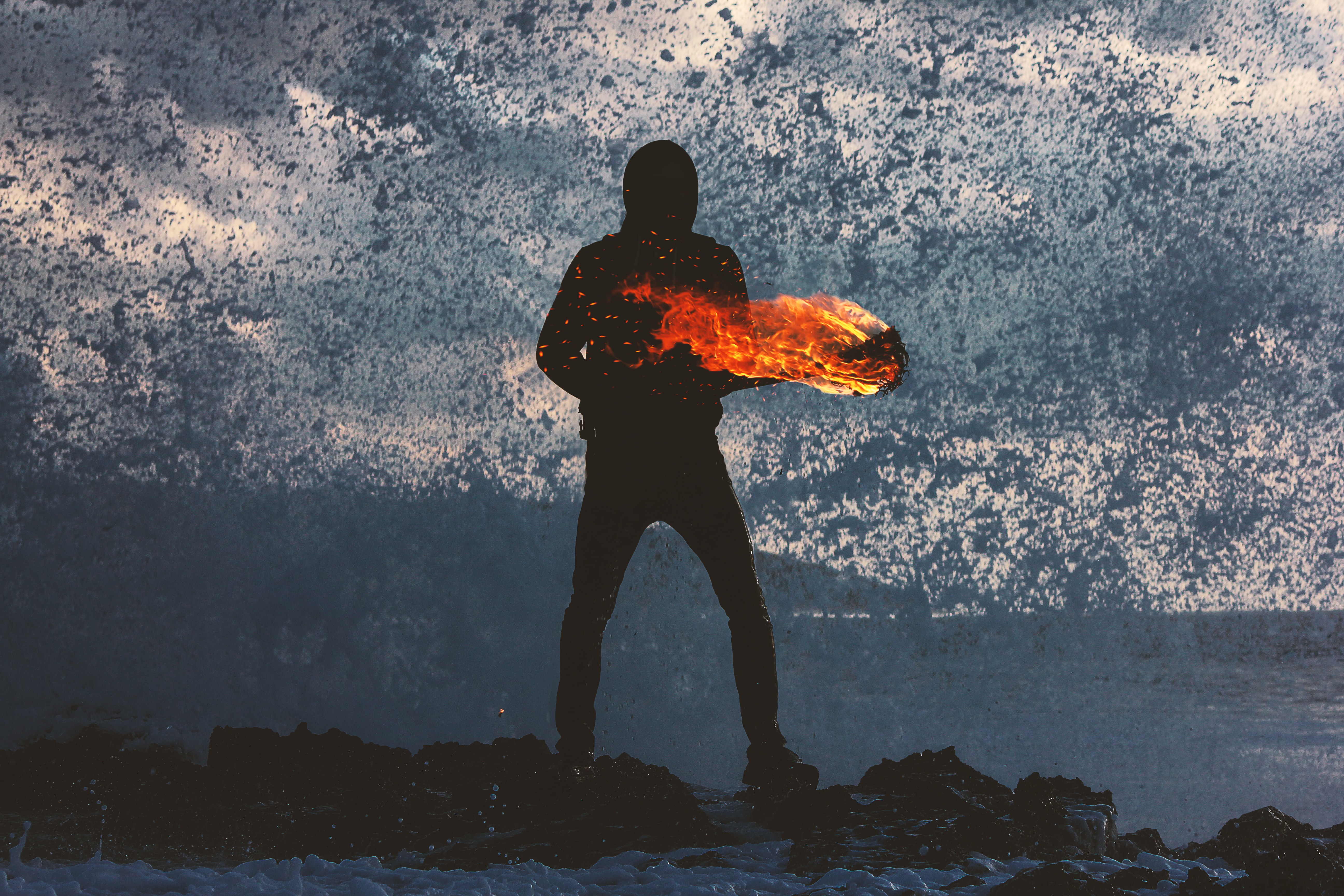silhouette of person standing holding torch
