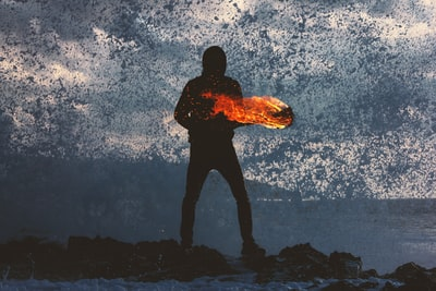 silhouette of person standing holding torch new teams background