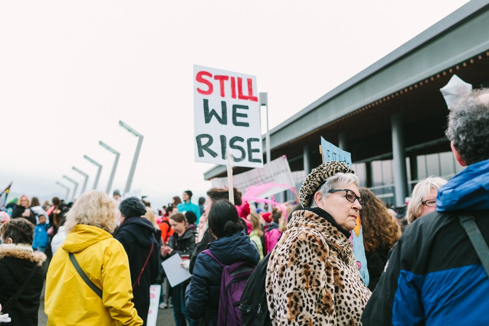 """The sign 'Still We Rise"""" is seen among the protesters in Vancouver."""
