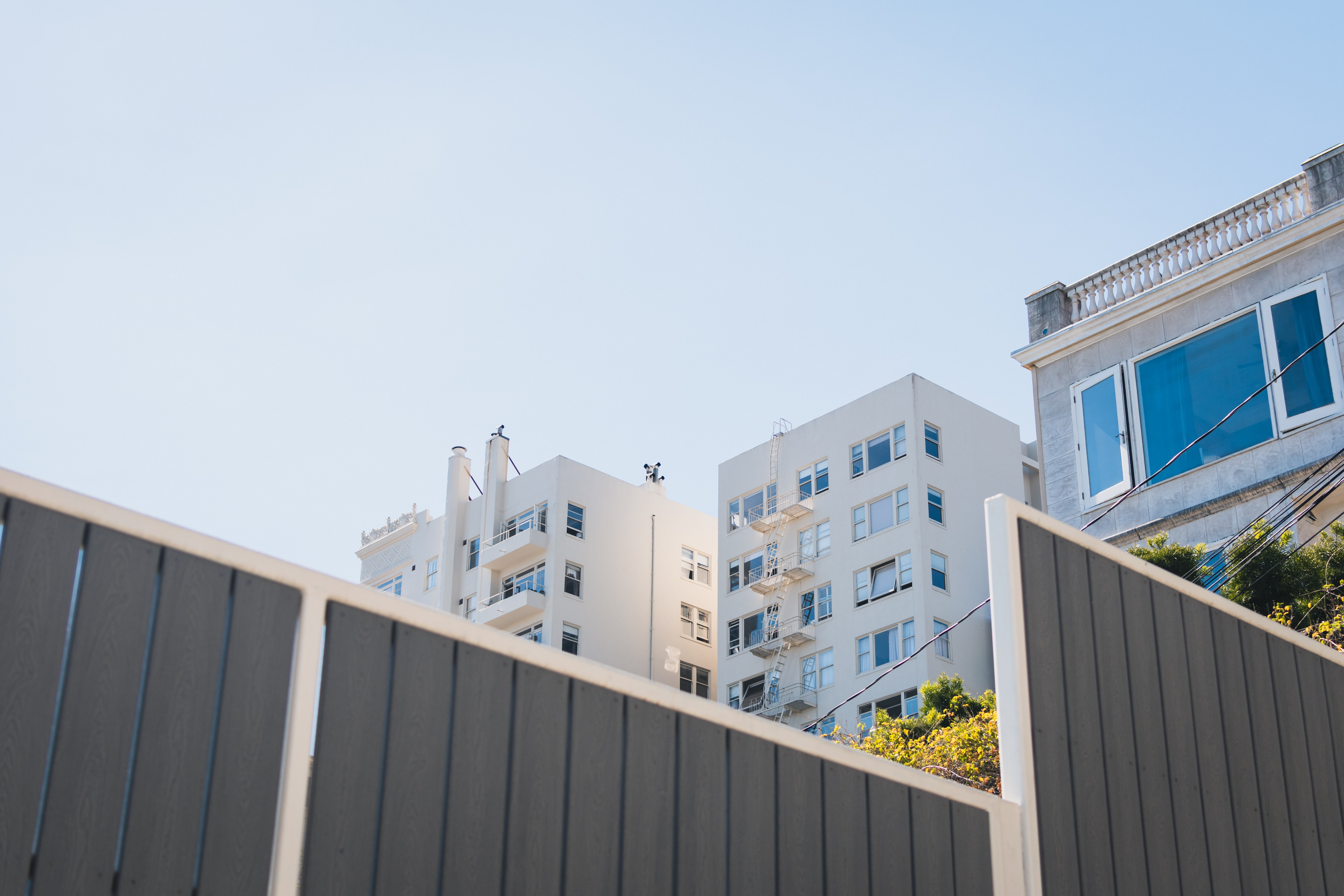 high-rise white concrete building under blue sky during daytime