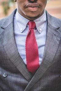 man in gray notch lapel suit jacket