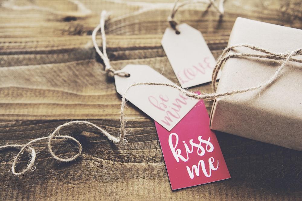Kiss Me tag on box
