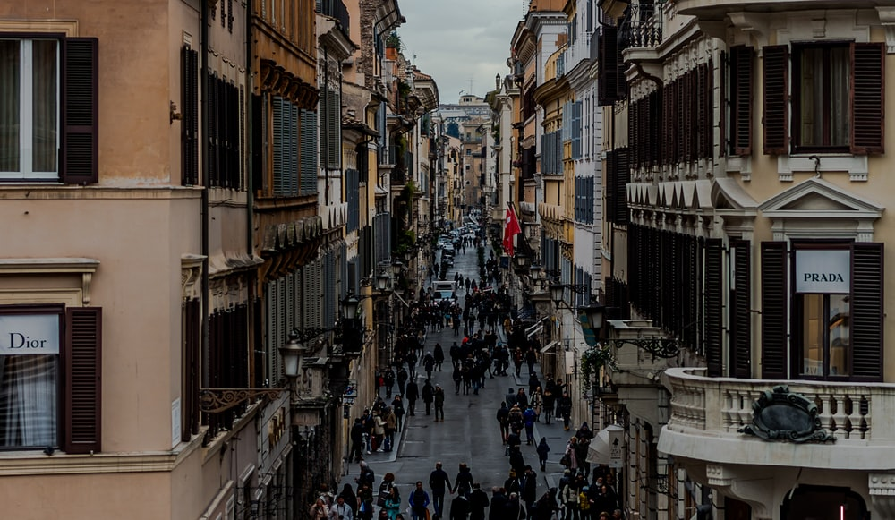 people in between two buildings at daytime