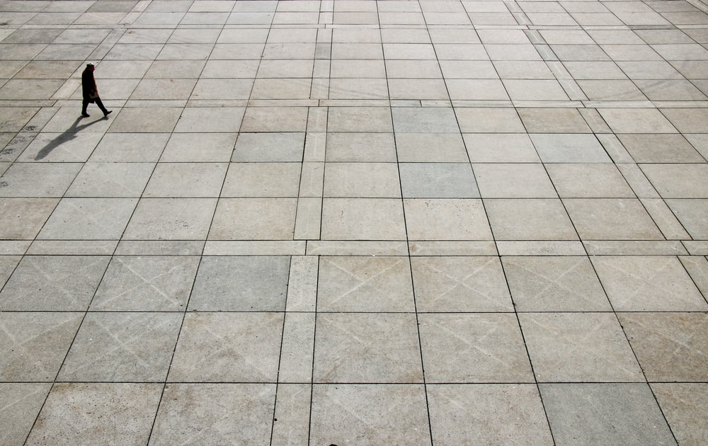 man walking on tiled ground at daytime