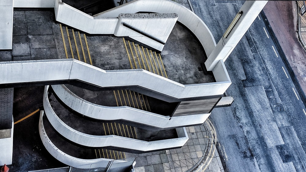 aerial photo of gray and white concrete stairs