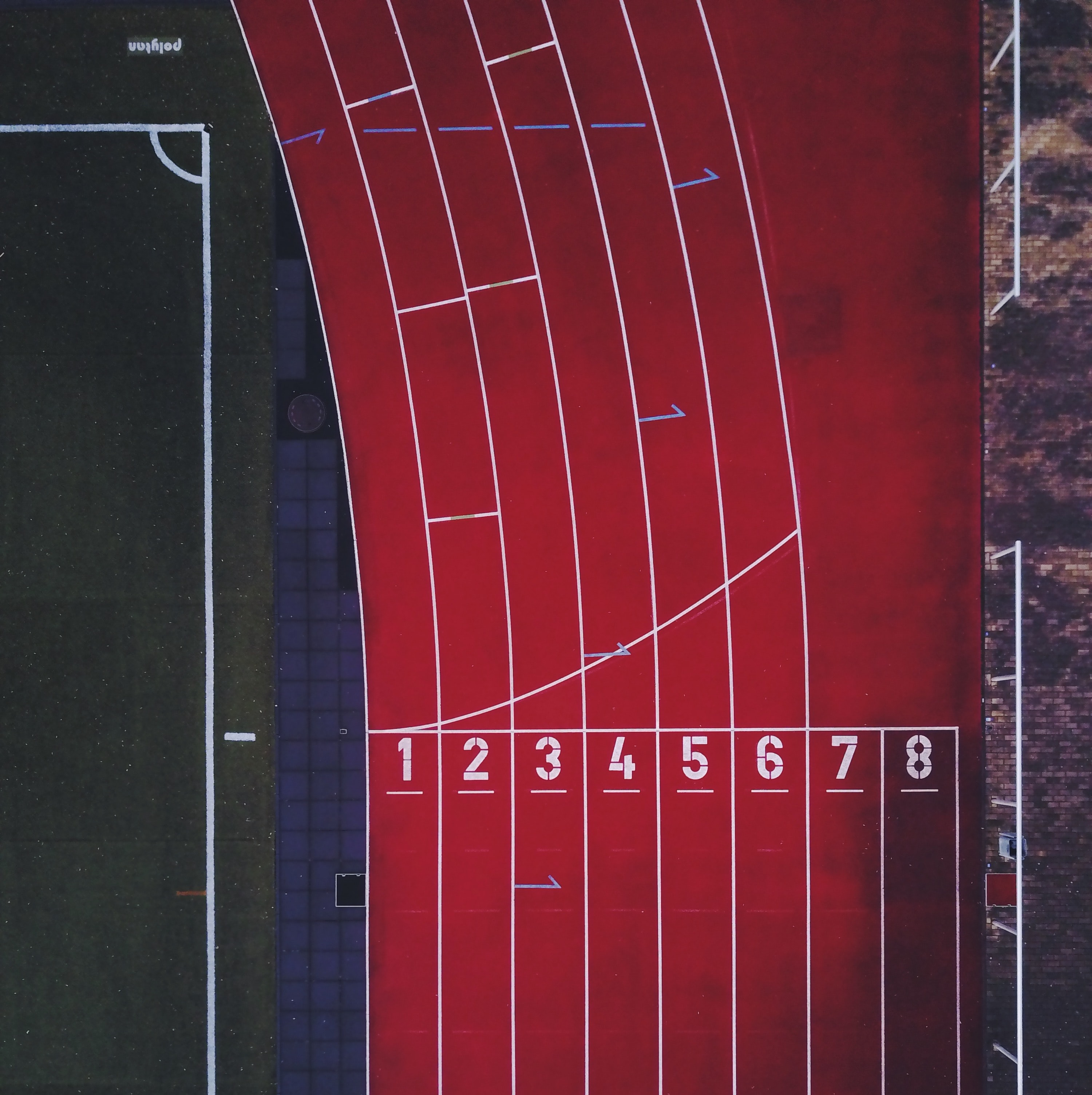 A drone shot of a running track in a stadium in Berlin