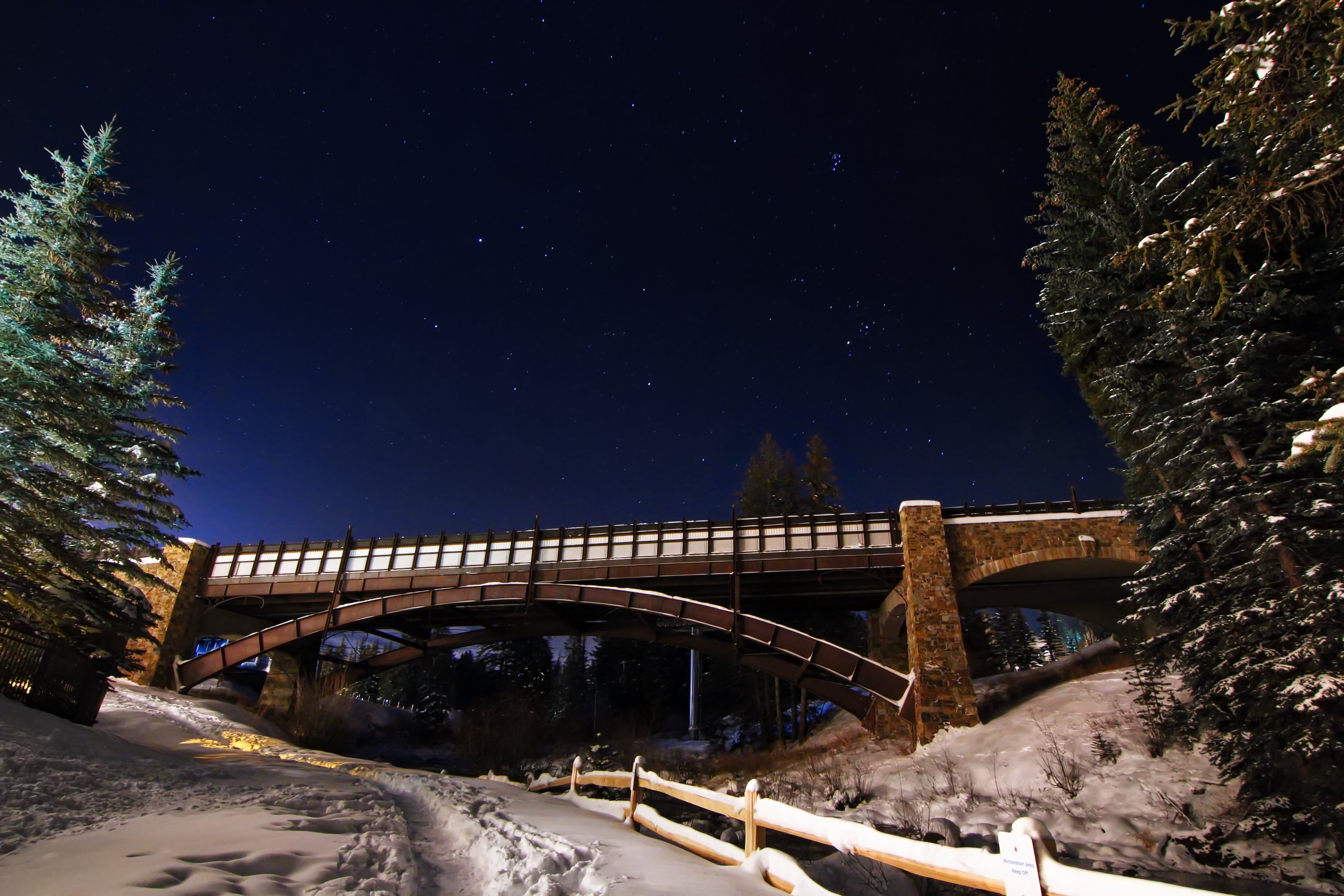 A bridge crossing over a fenced road at the Vail Ski Resort in Colorado