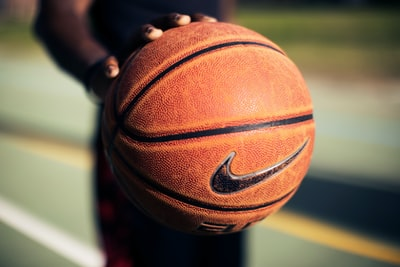 person holding brown Nike basketball