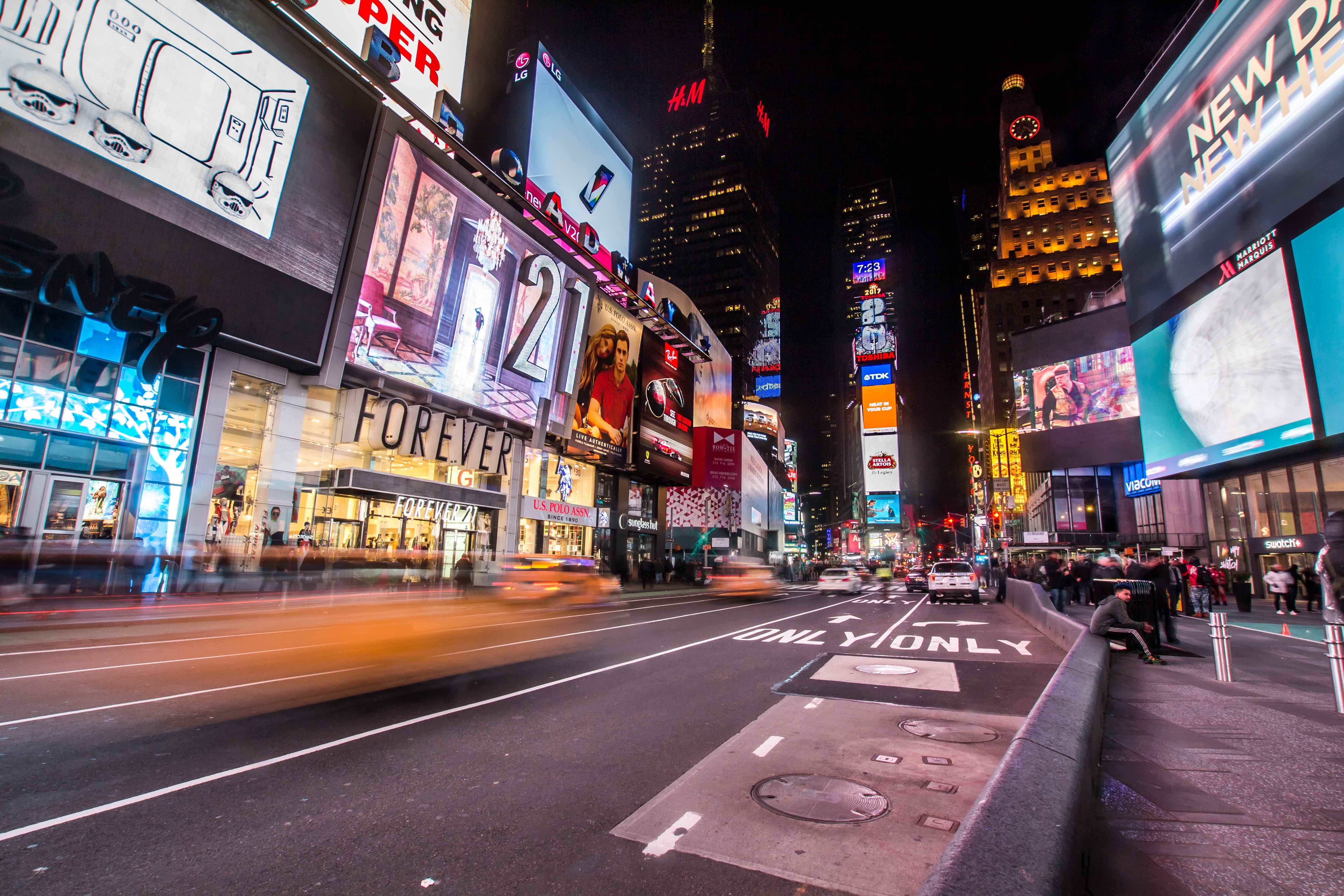 Time lapse shot of cars driving through Times Square, New York at night-time