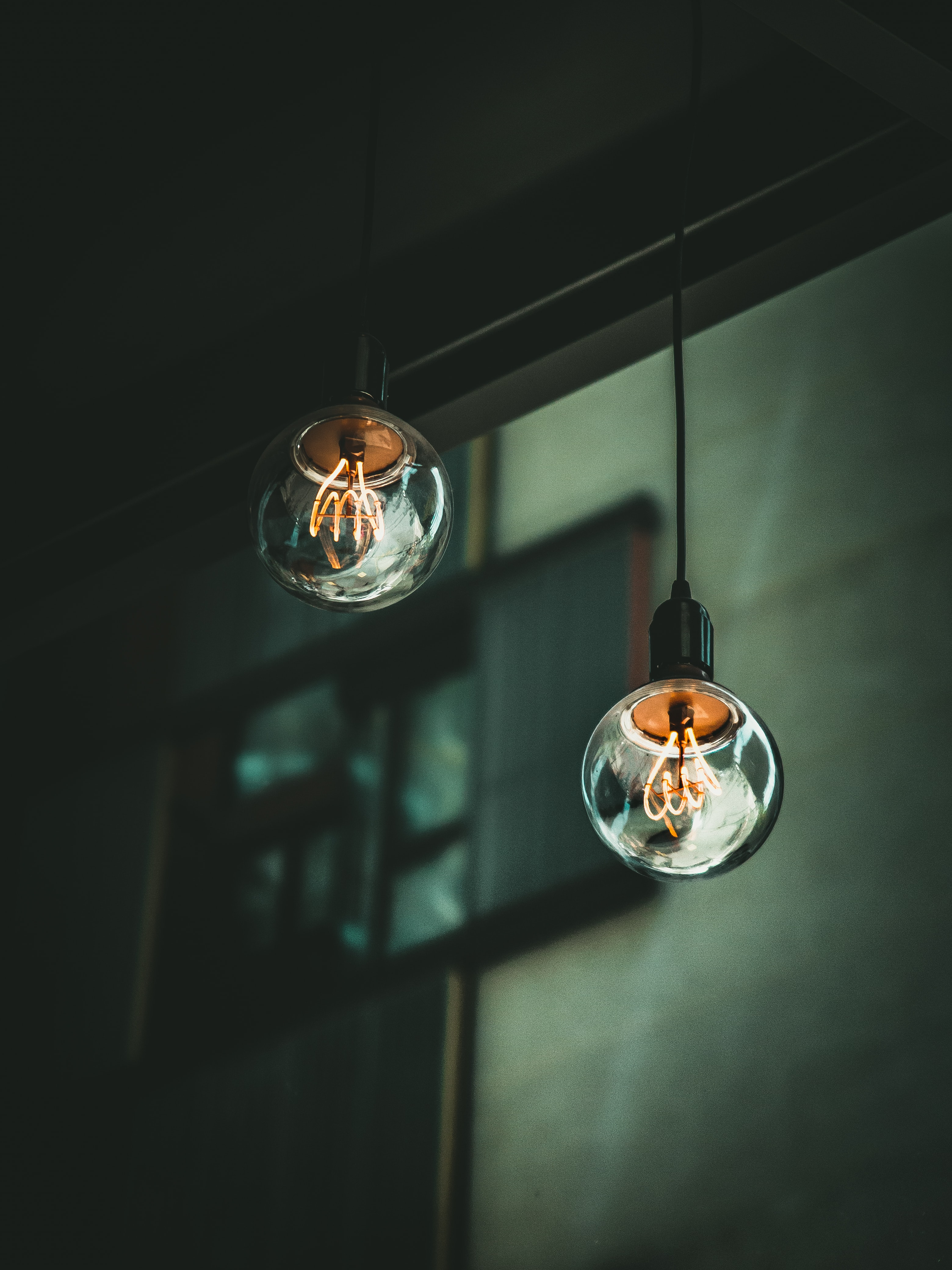 two switched on pendant lamps