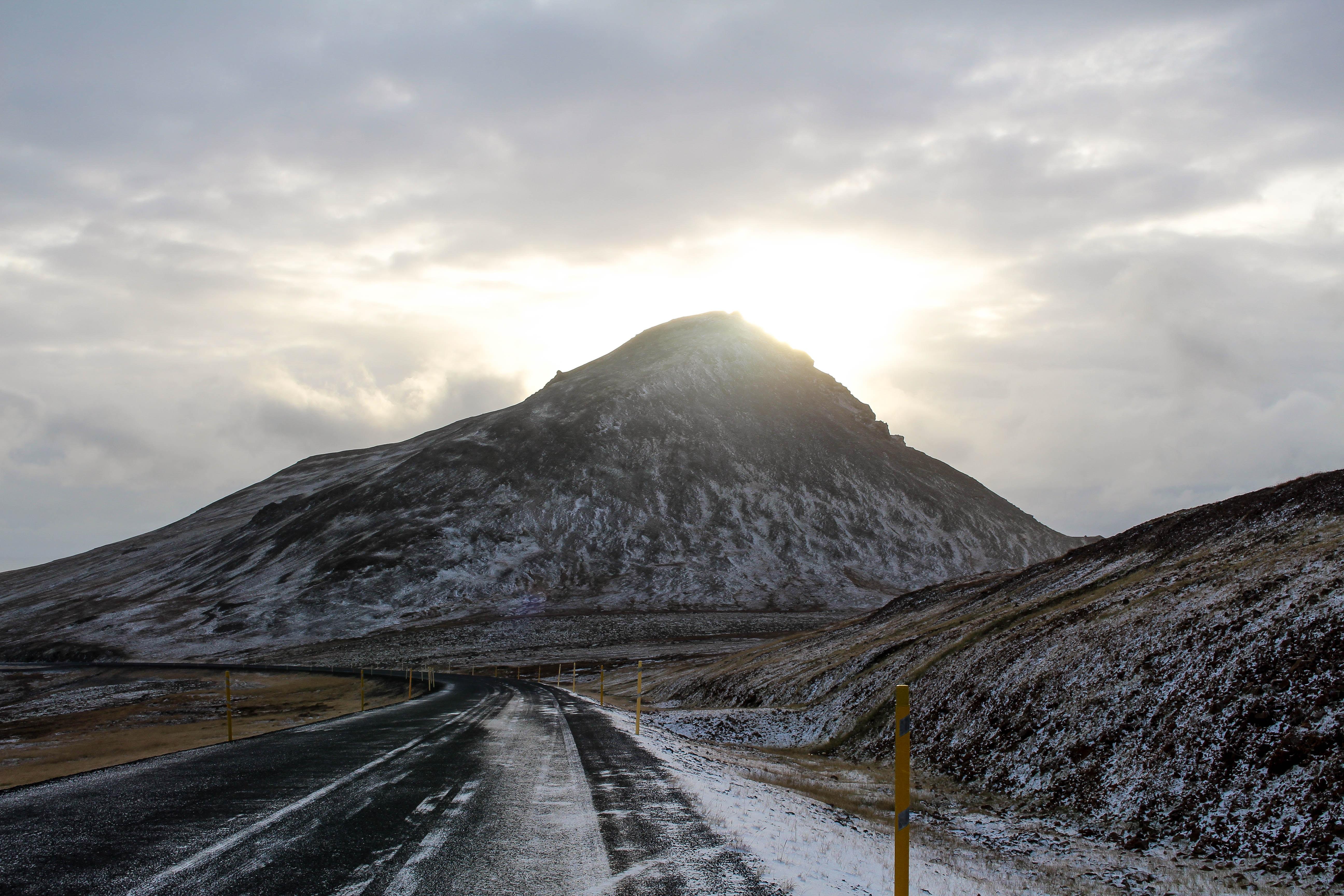mountain near asphalt road during daytime