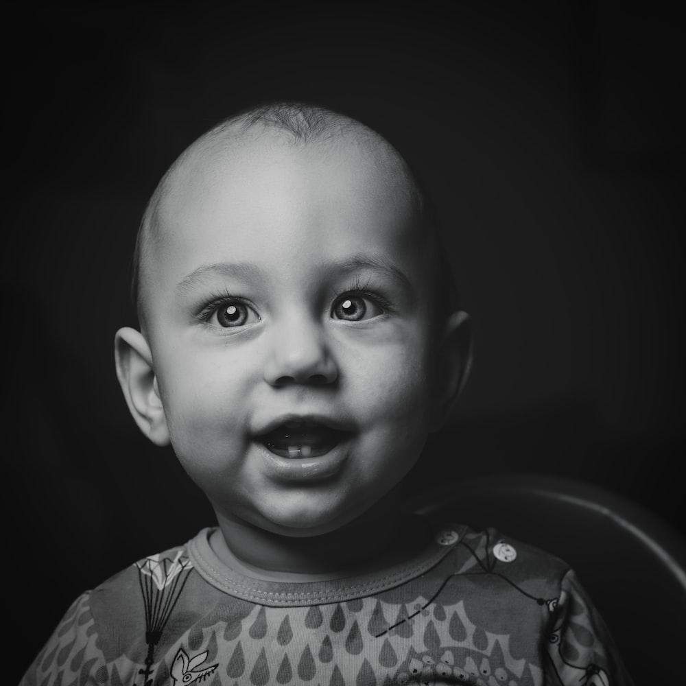 baby's crew-neck top grayscale photo