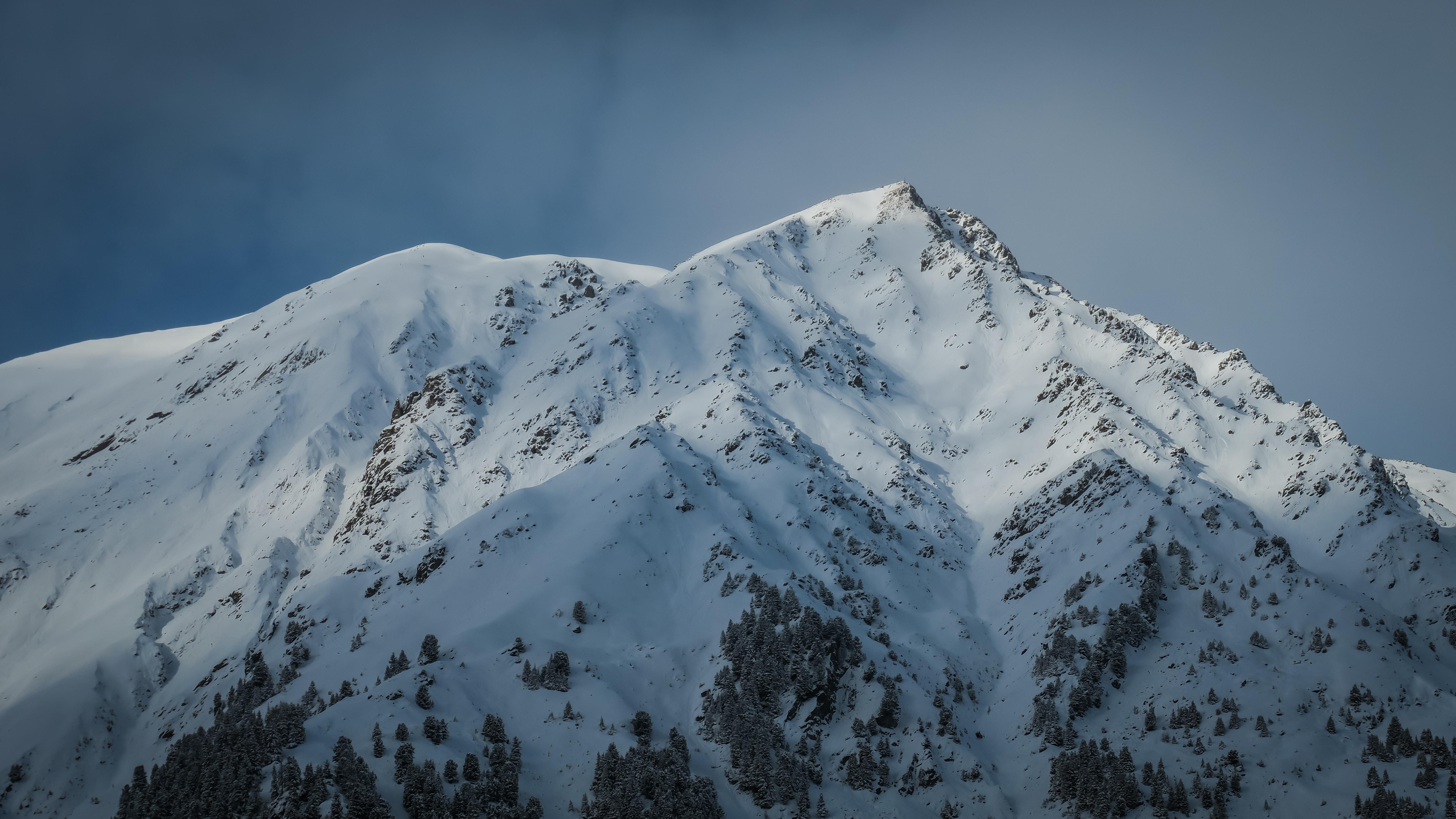 The snowy peak of Juifenalm under dark blue sky