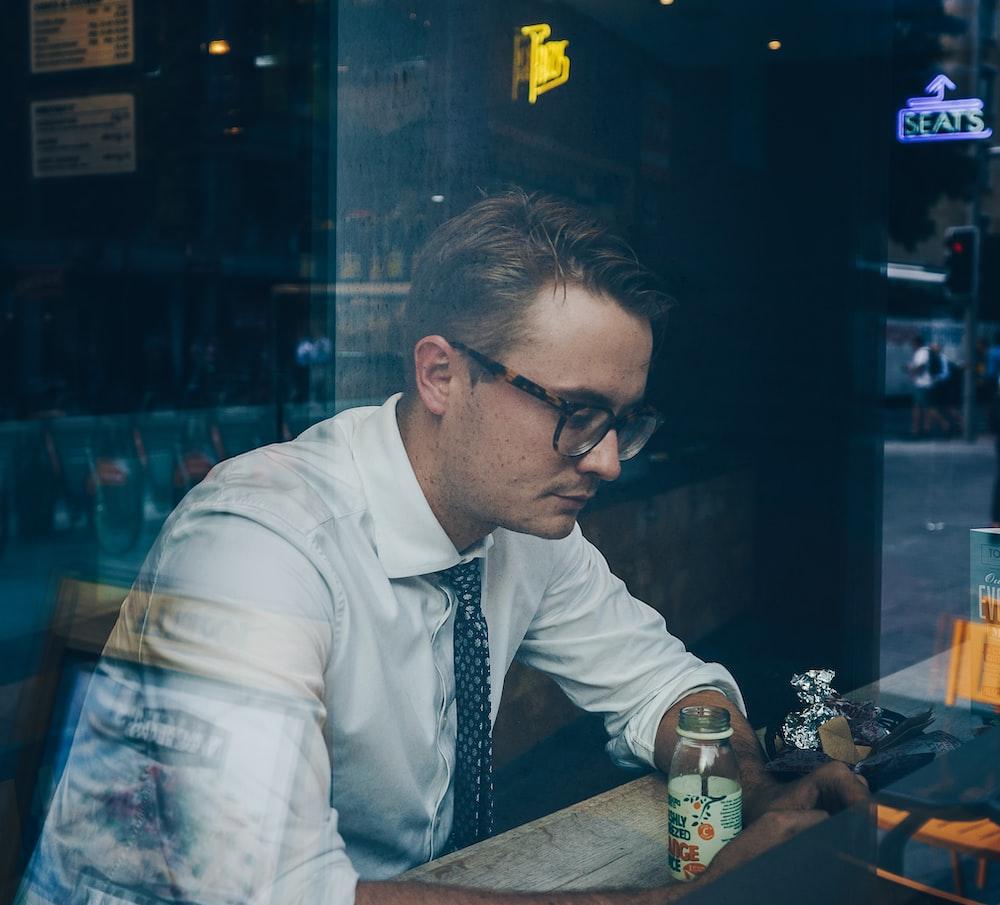 man wearing sunglasses inside cafe