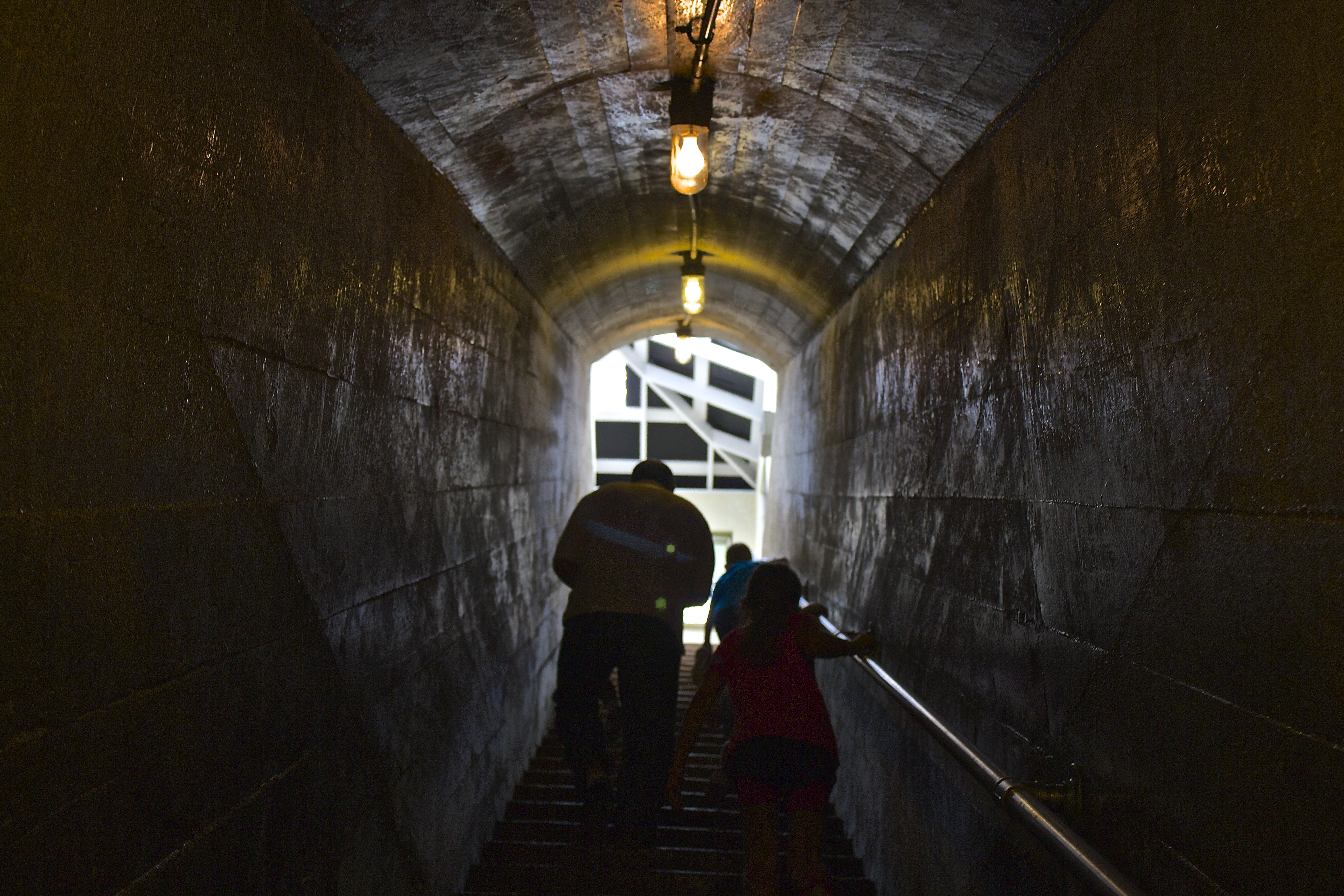 man and child passing through tunnel