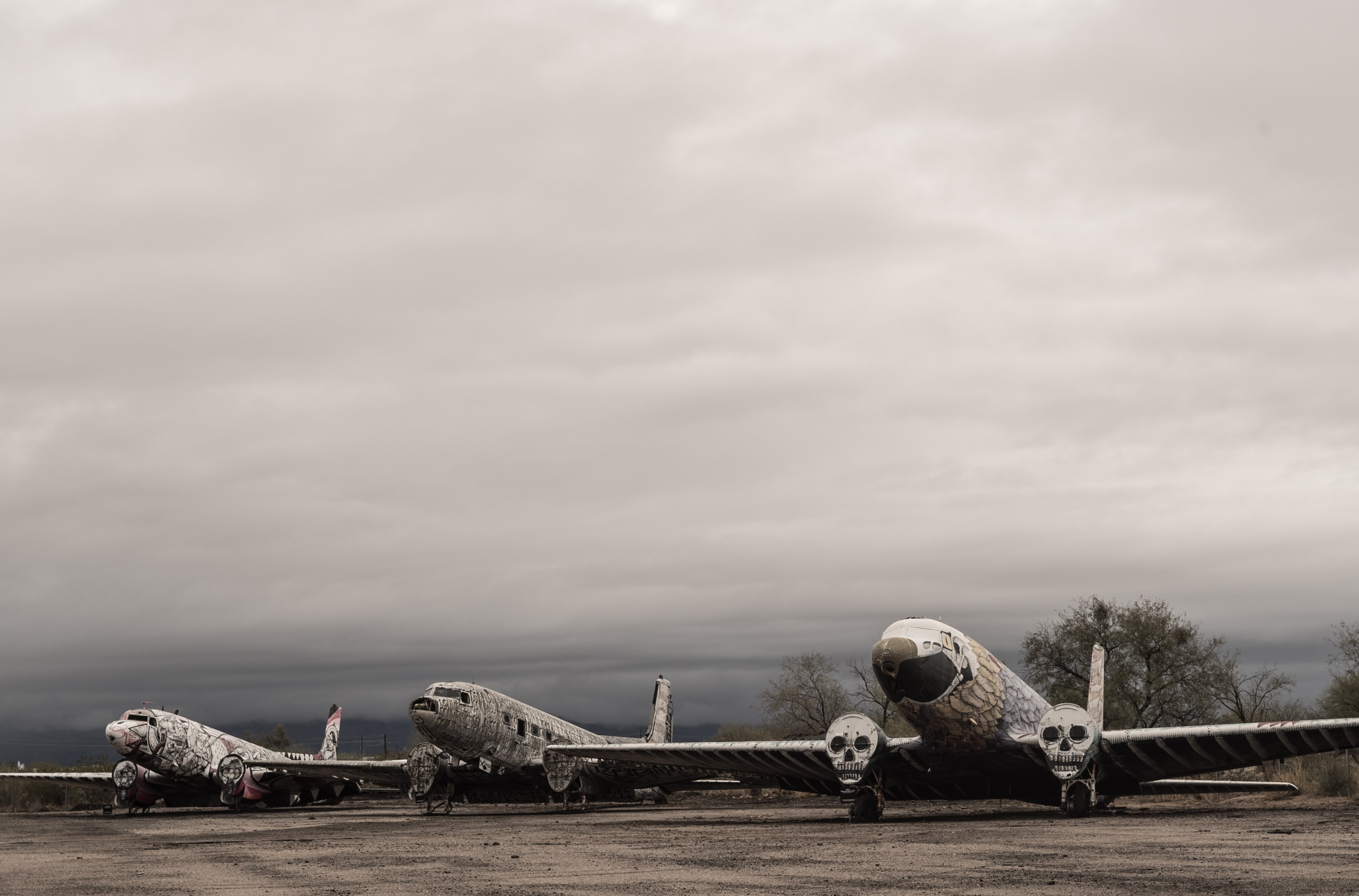 Line of vintage military planes decorated with skulls