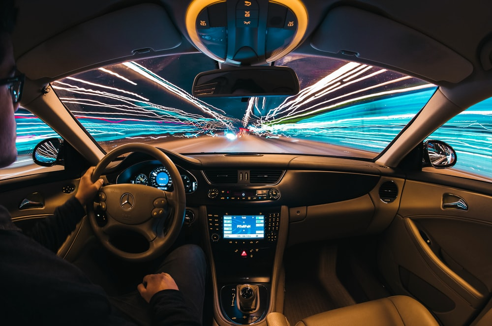 time lapse photography of man riding car