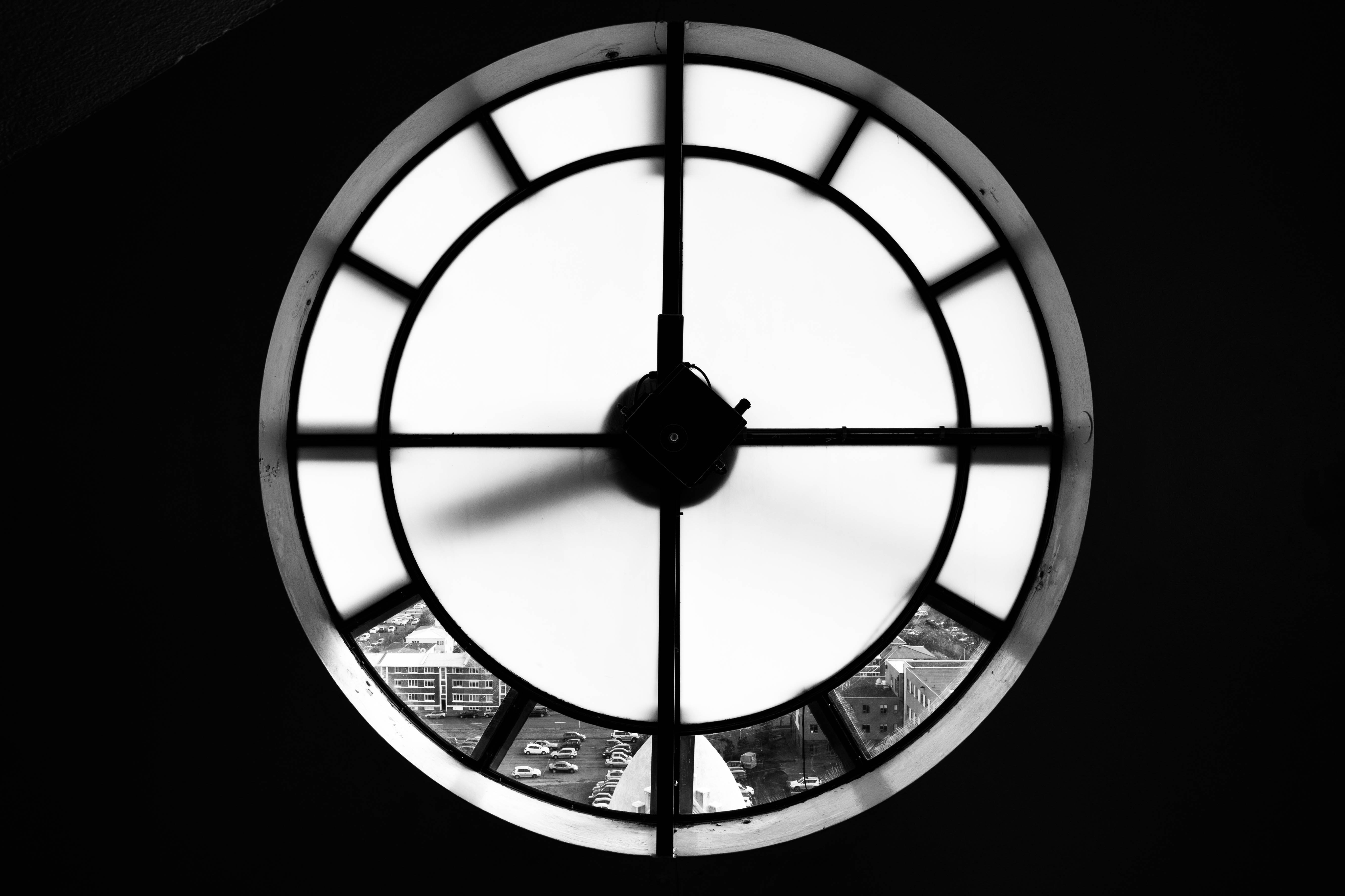 Macro black and white shot of round clock on dark background, Hallgrimskirkja