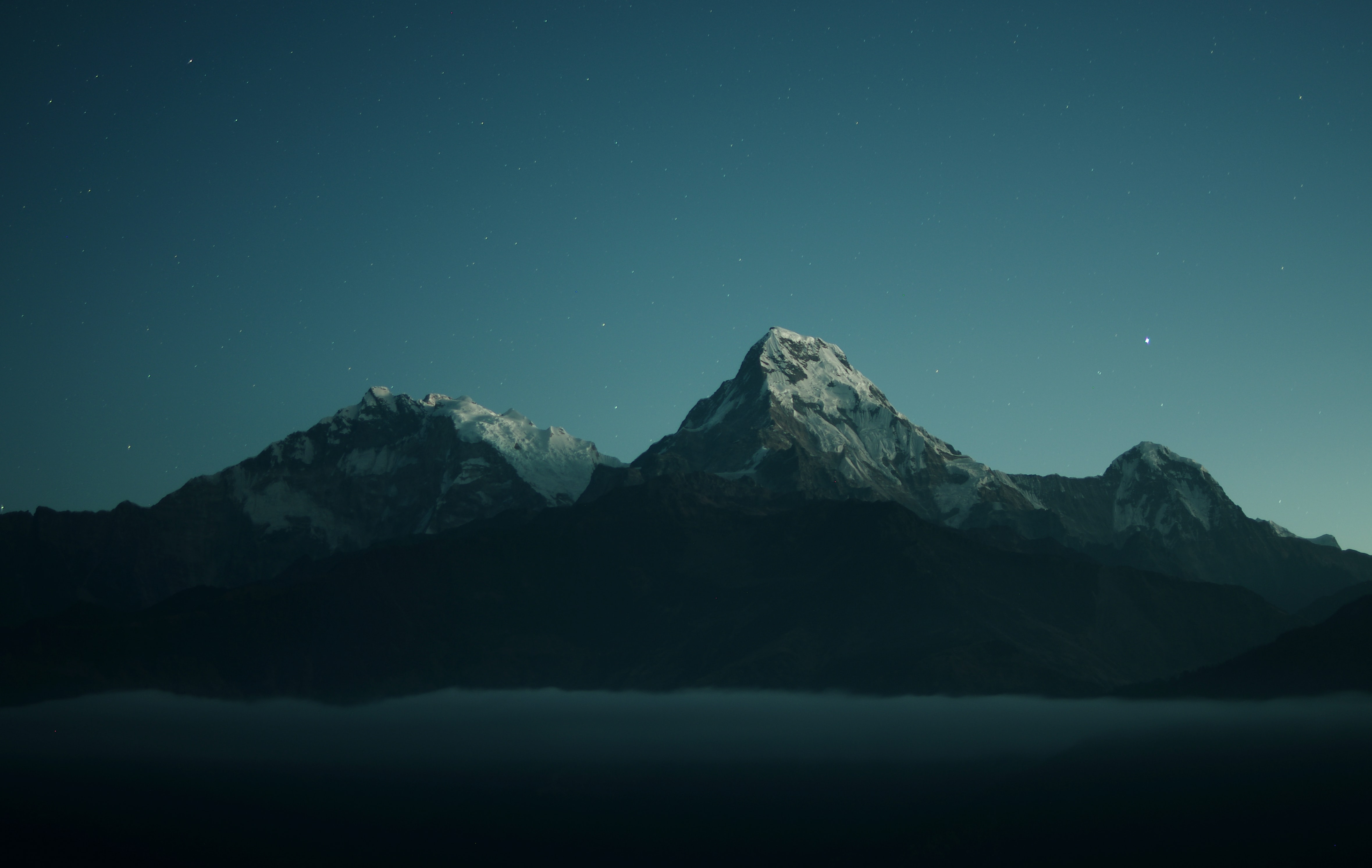 silhouette of mountains during nigh time photography