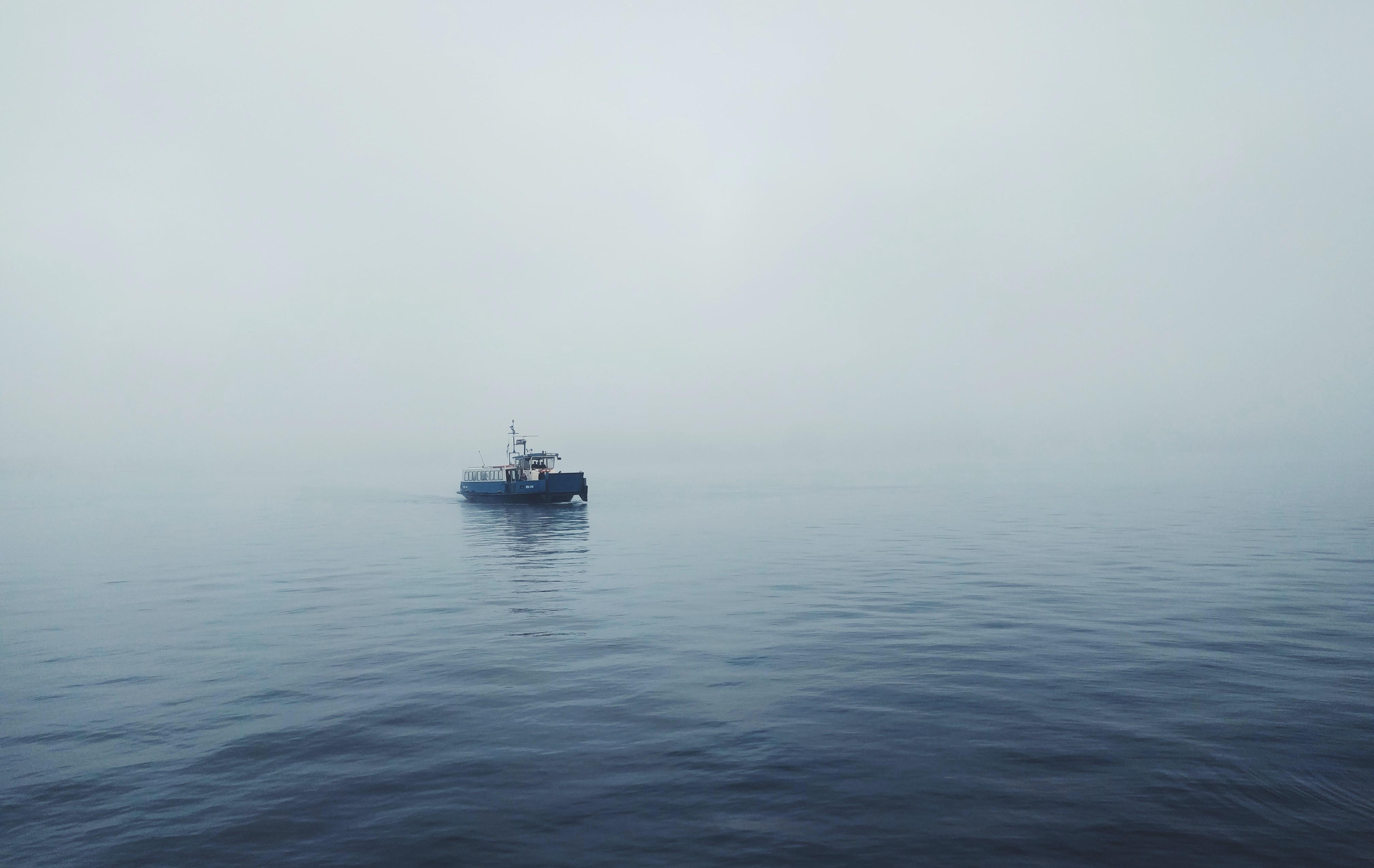 Working boat crosses a foggy sea in Amsterdam