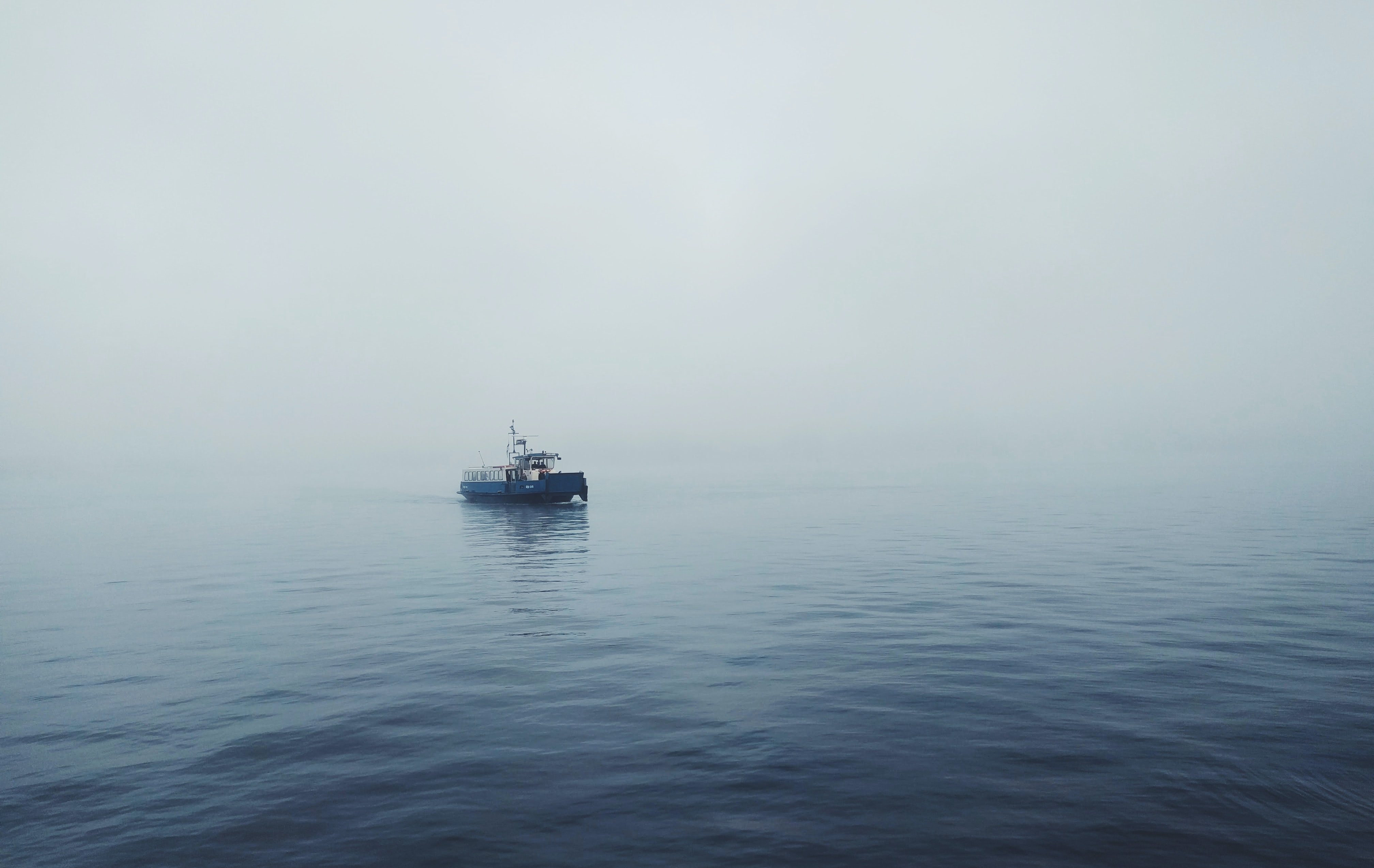 Working boat crosses a foggy sea in Amsterdam