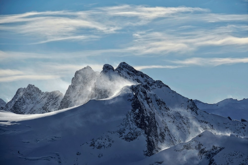 snow covered mountain over horizon