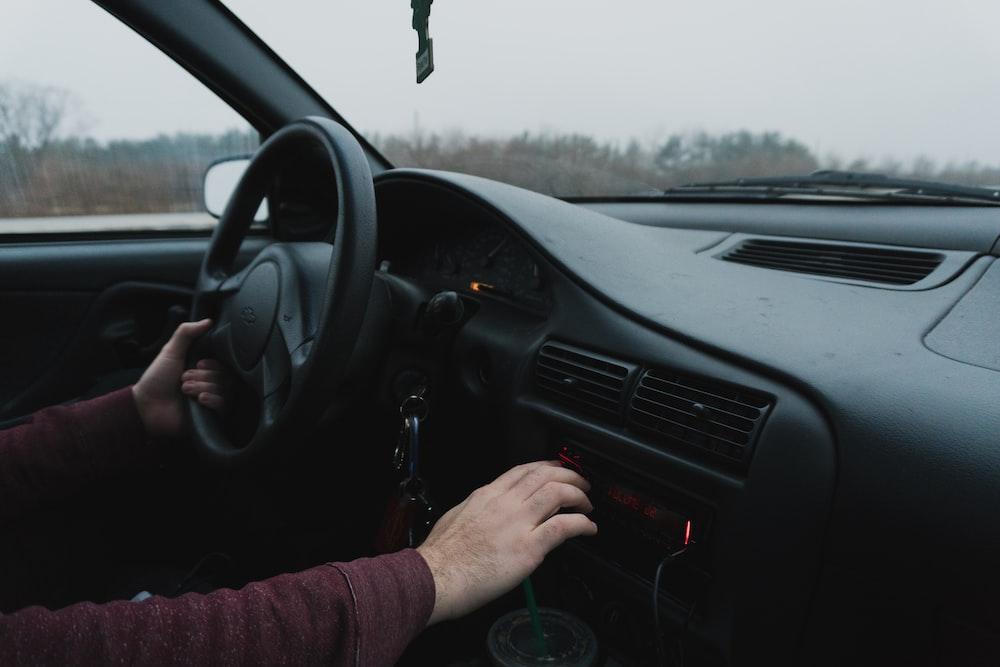 person driving black car
