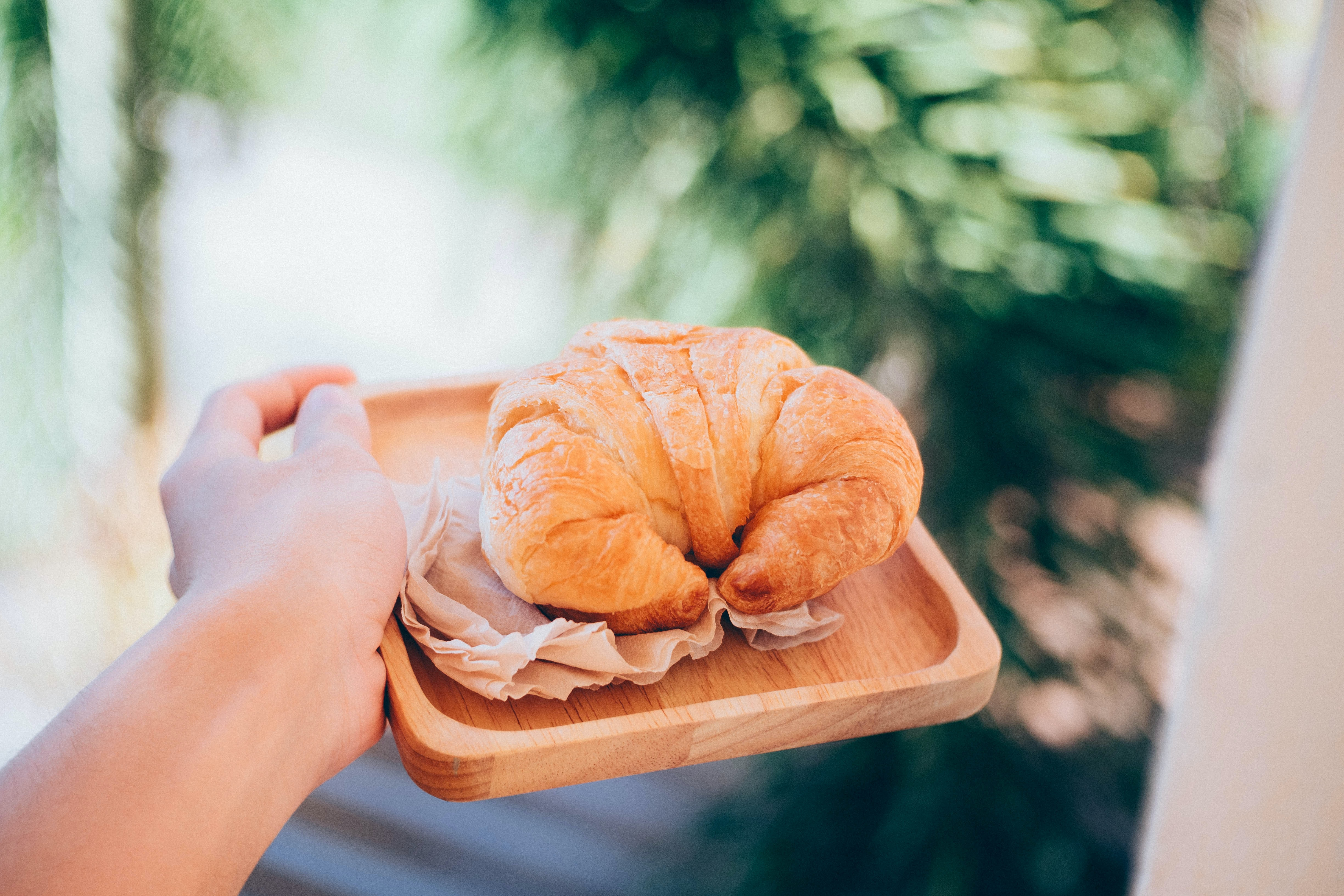 croissant on wooden plate