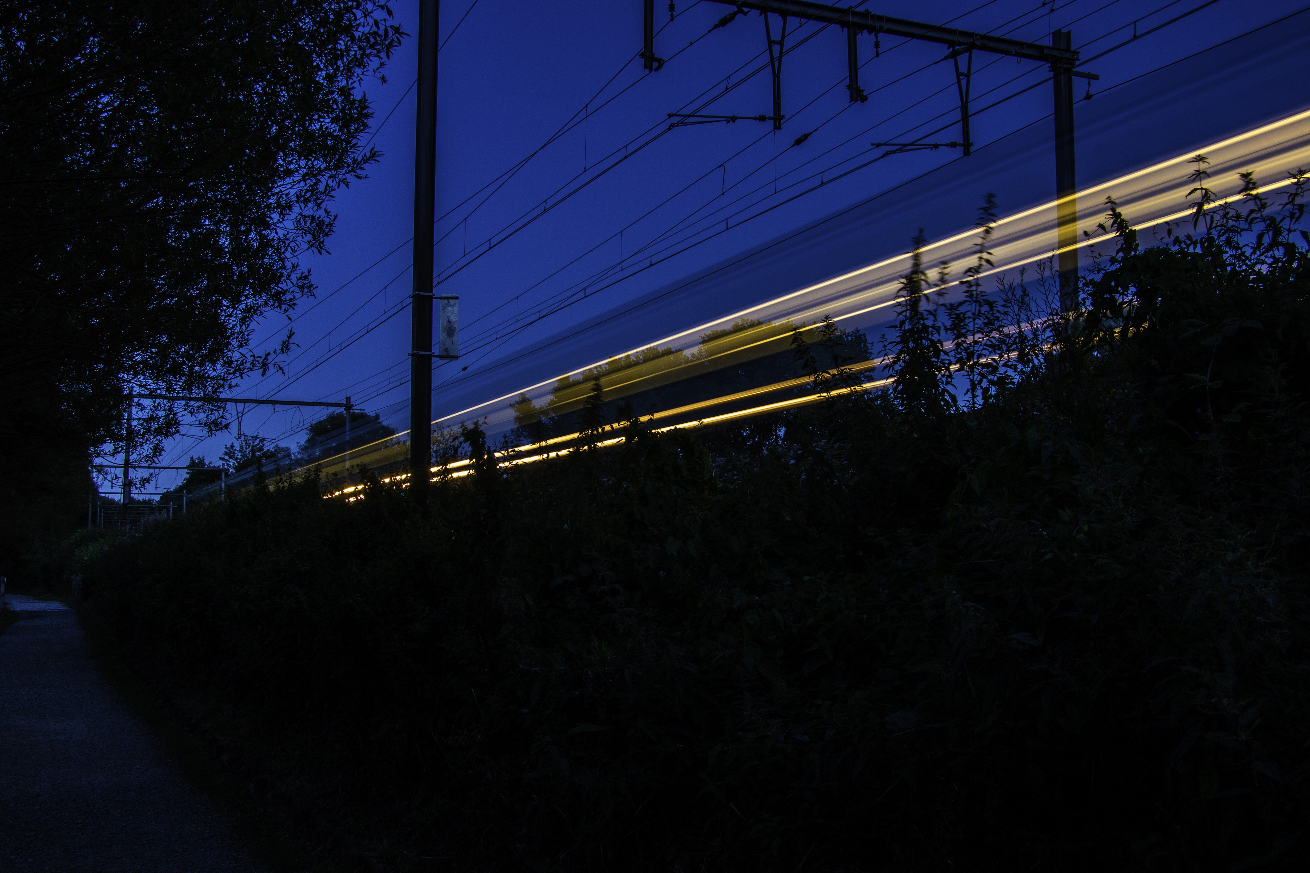 time lapse photography of train rail