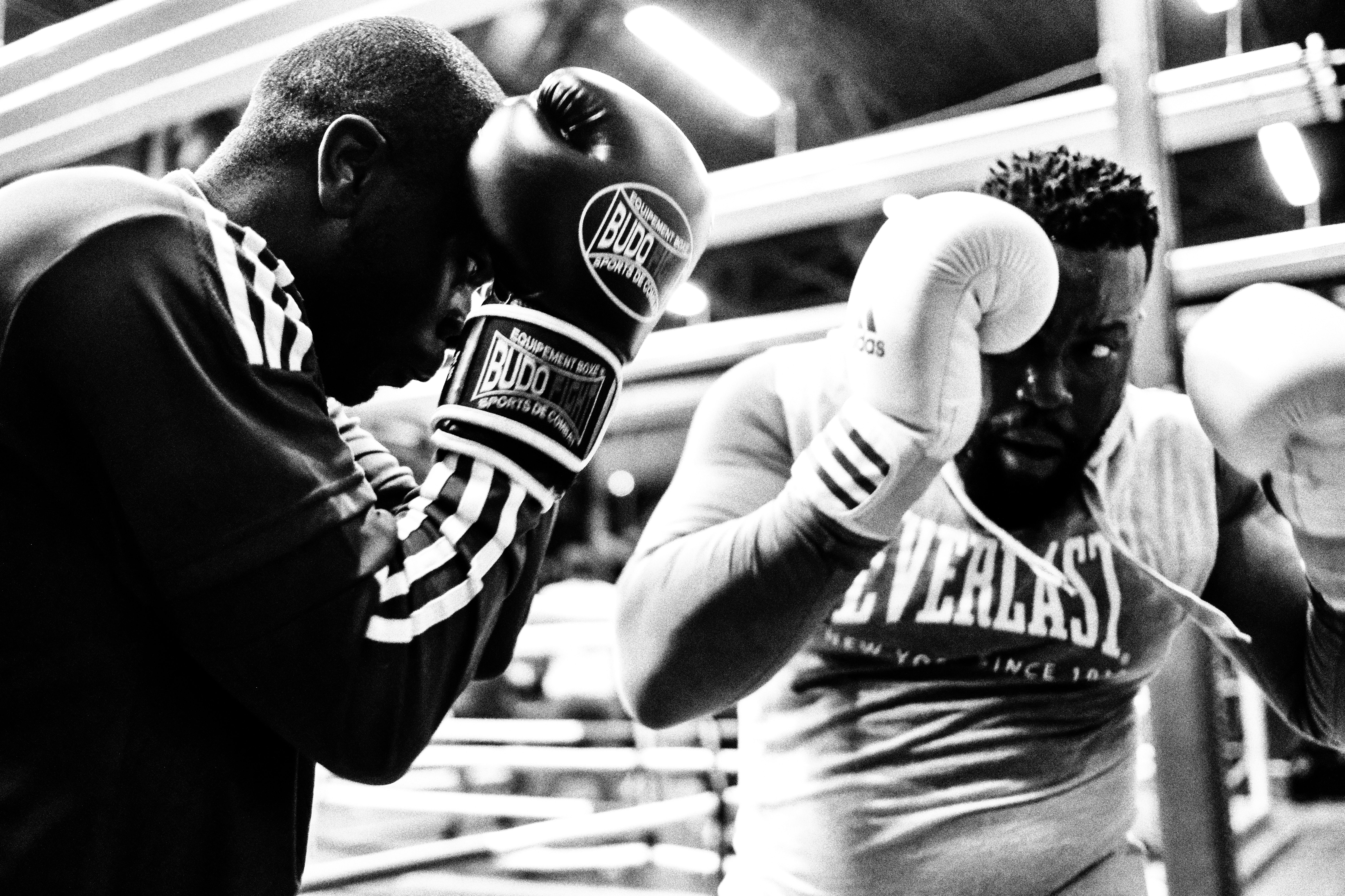 Two African American men training with boxing gloves