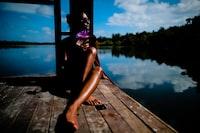 woman sitting near body of water