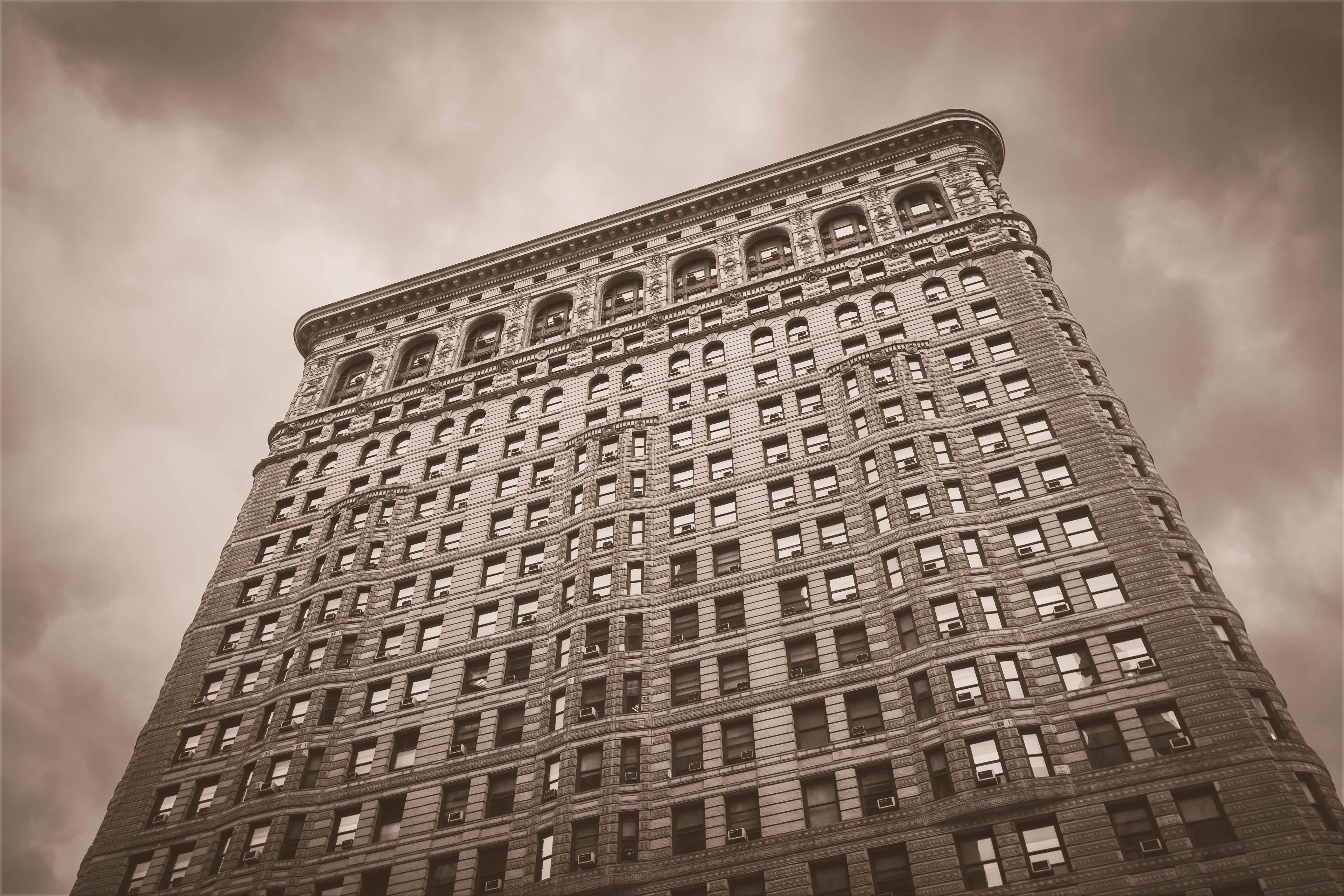 low angle sepia photography of a high-rise building