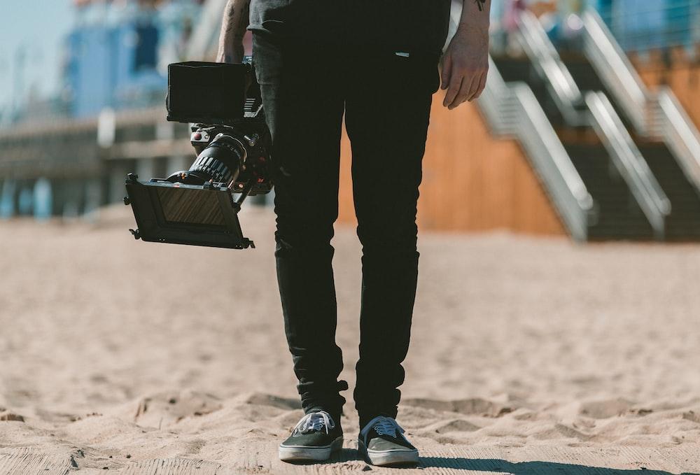 person holding shoulder-mount camcorder