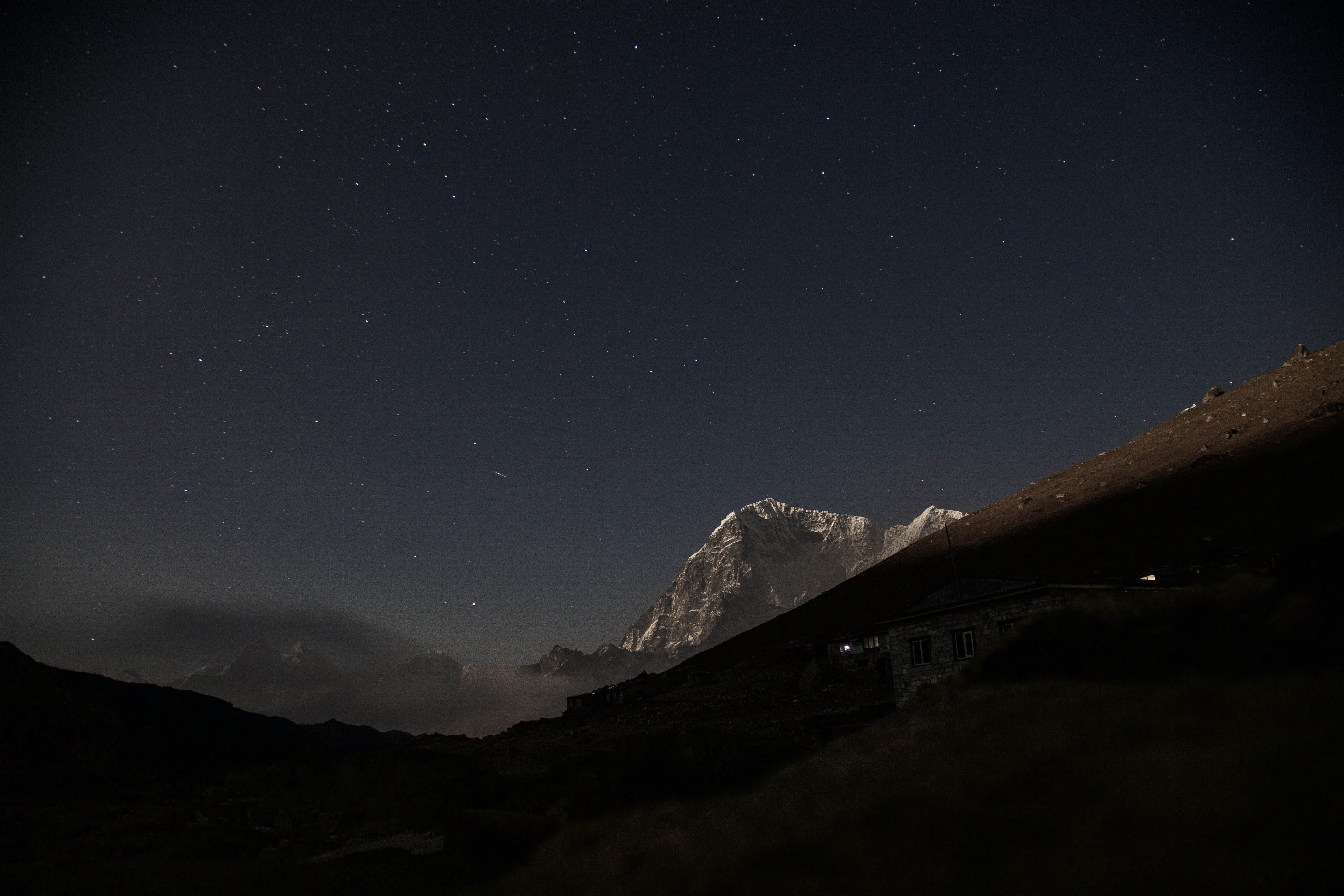 Starry night sky over the towering mountains in Nepal