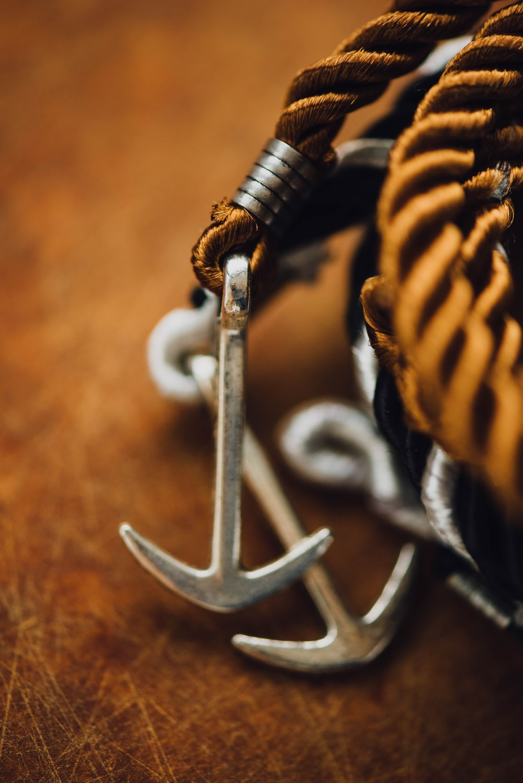 silver-colored anchor accessory