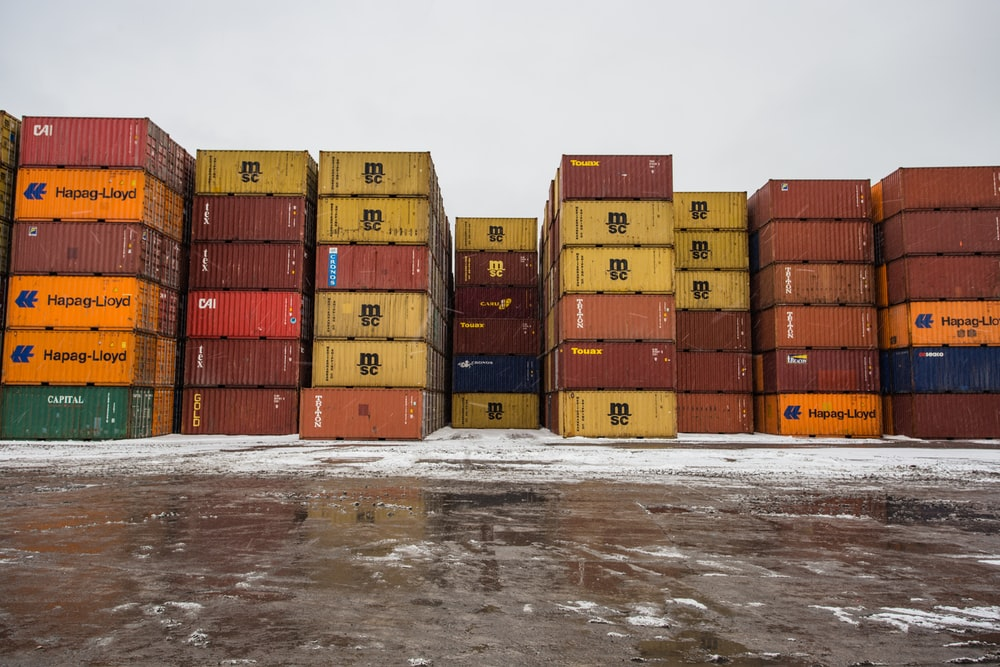 assorted-colored cargo container lot during daytime