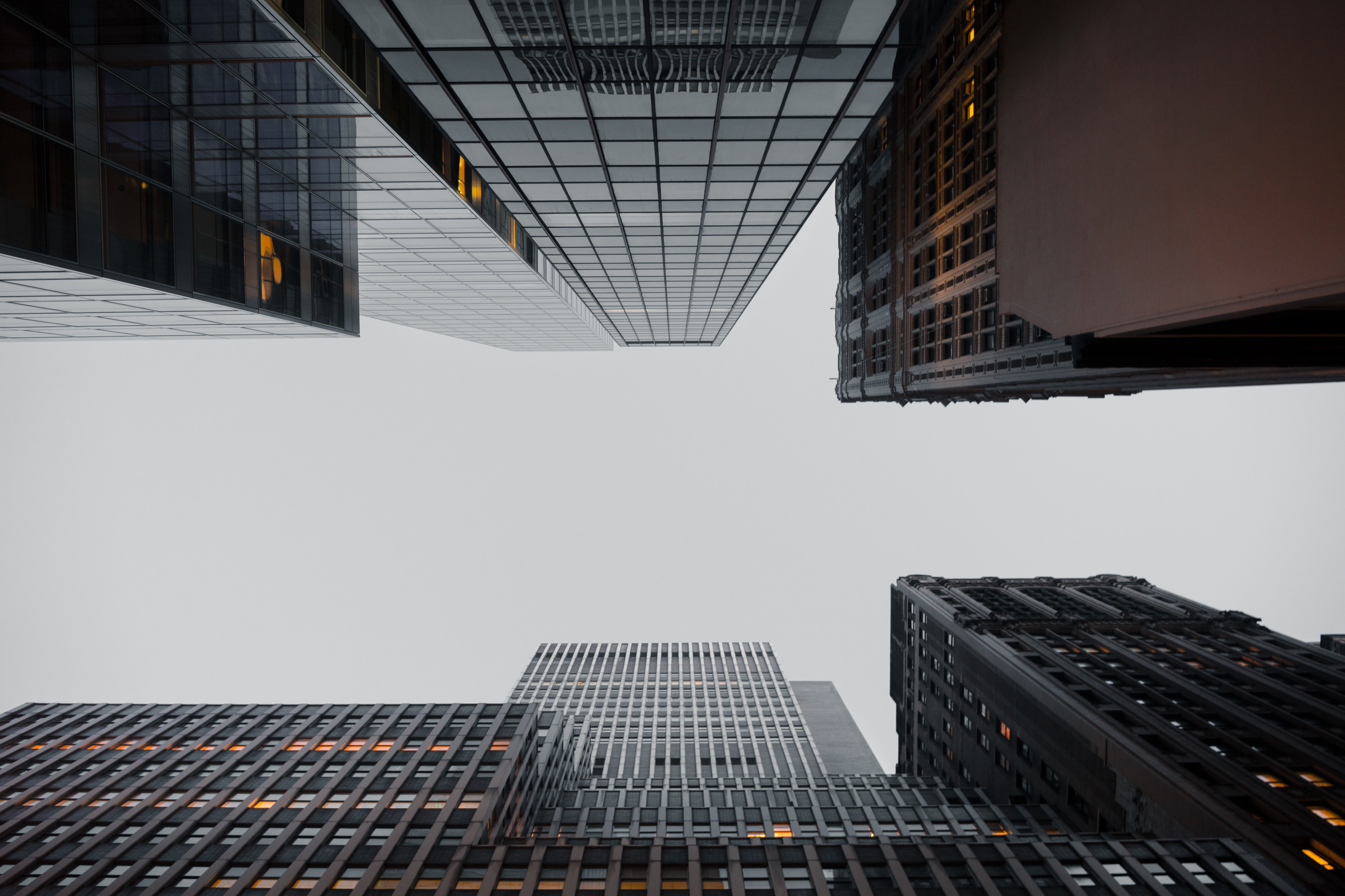 A low-angle shot of an overcast sky over skyscrapers in Manhattan