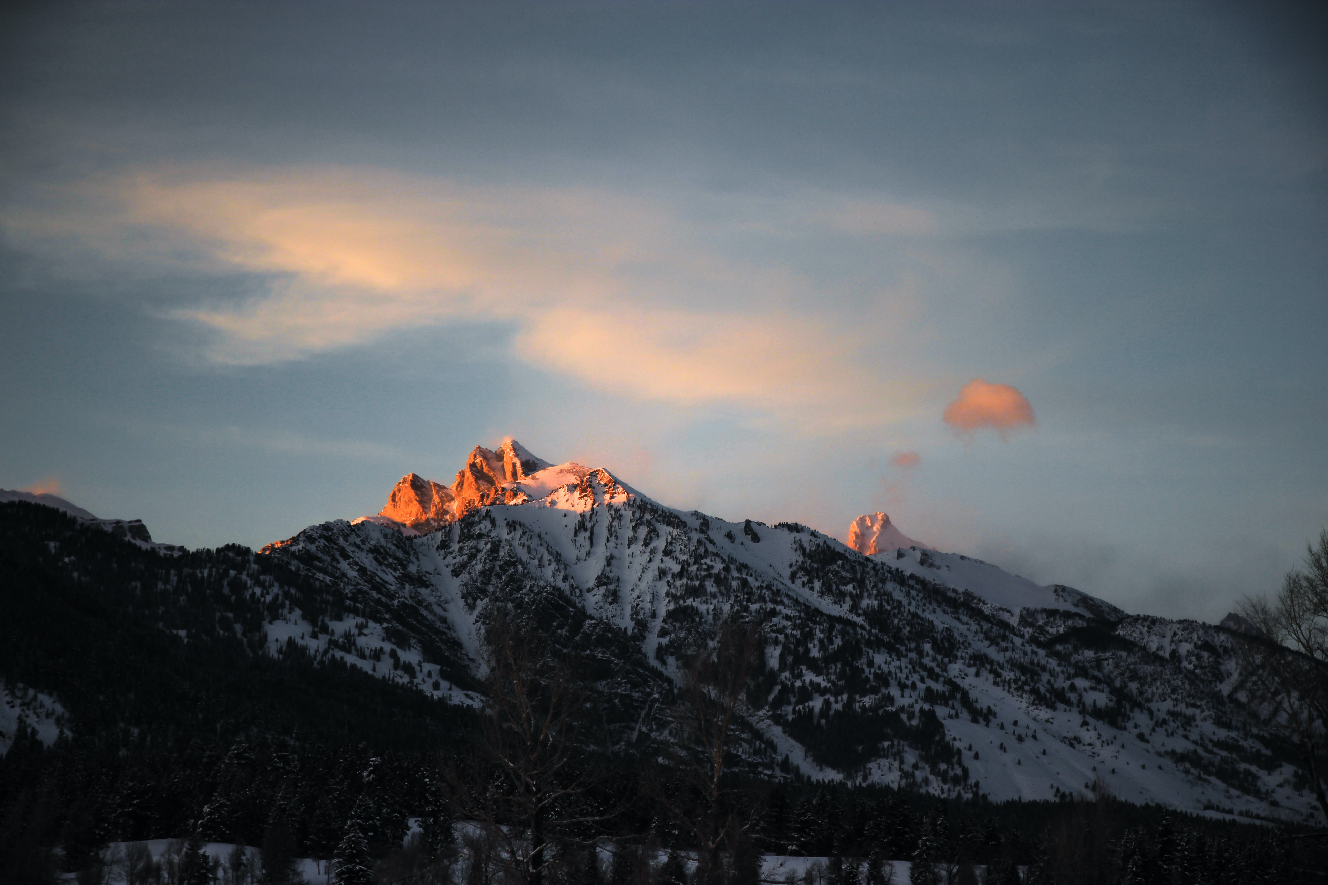 mountain covered by snow during sunset