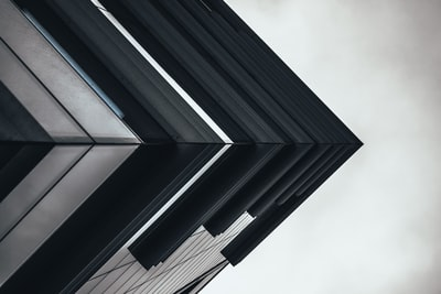low angle photography of building geometry teams background