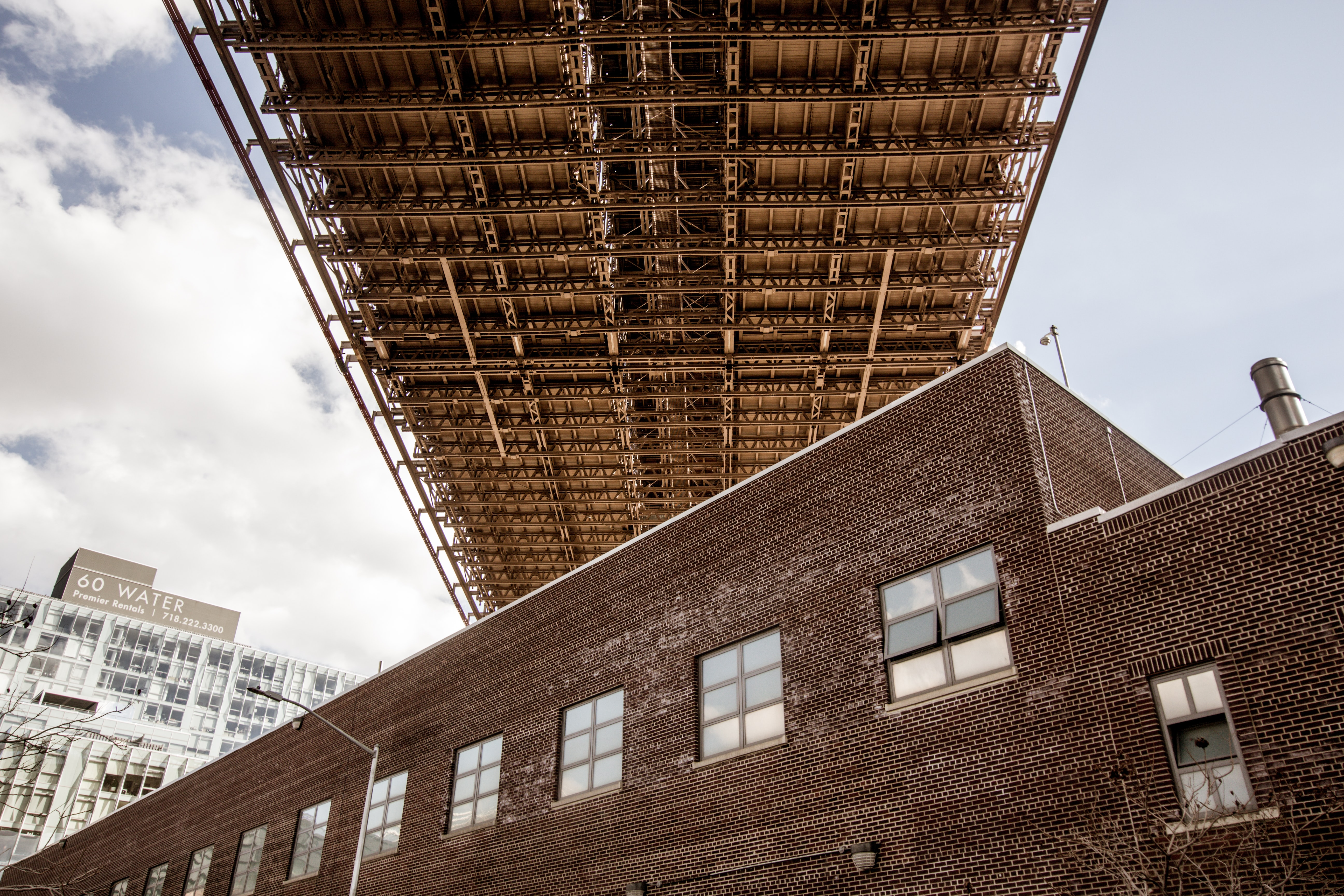 A brick building under the ramp of the Brooklyn Bridge in New York City