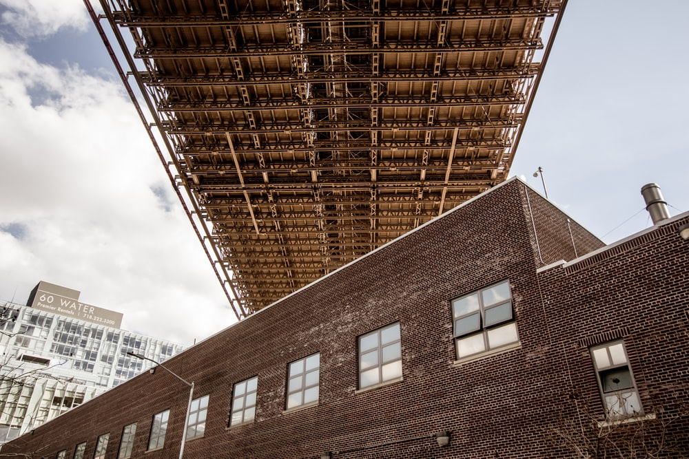 low angle photo of brown concrete building