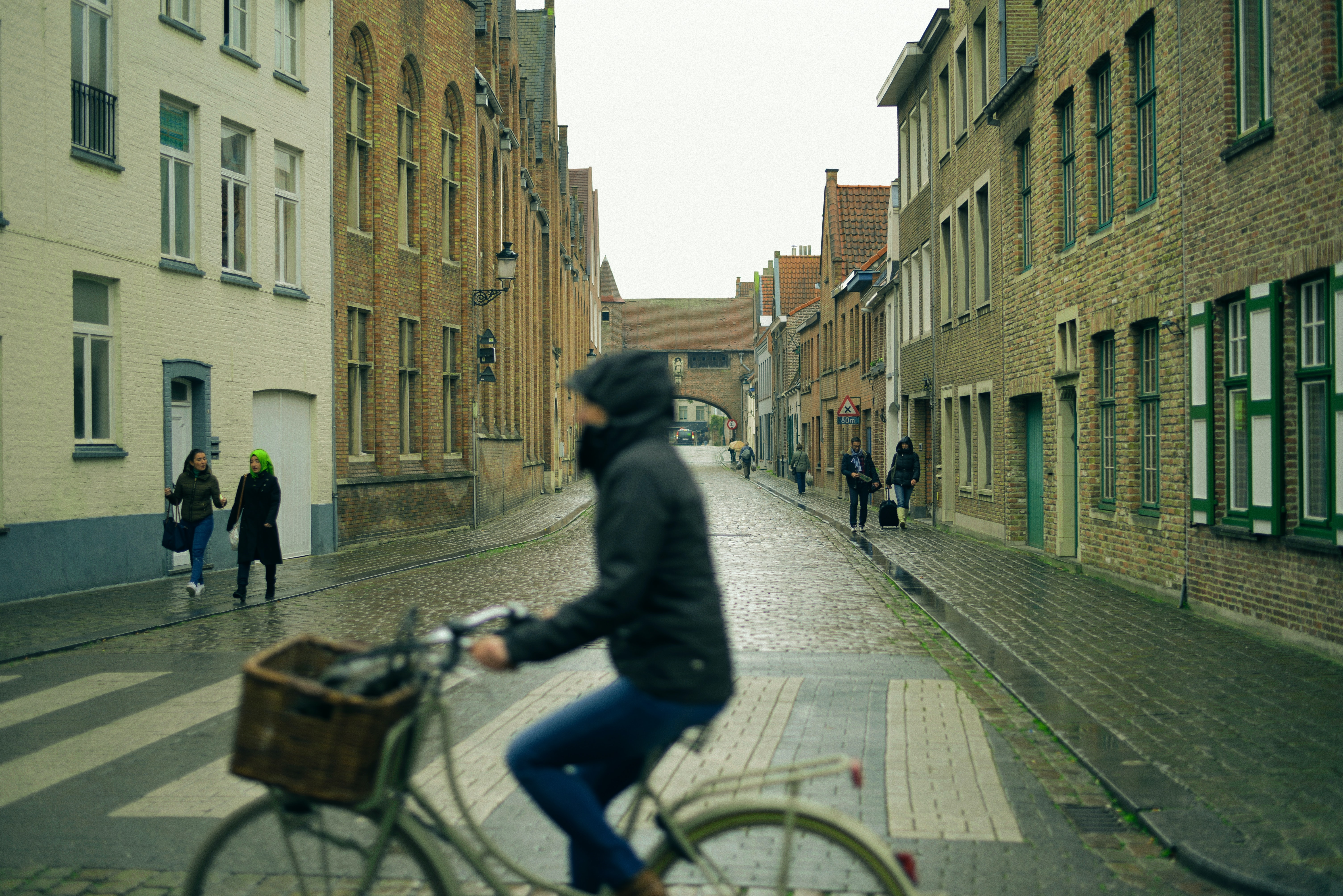 selective photography of people walking on sidewalks at side of buildings view from person riding city bicycle