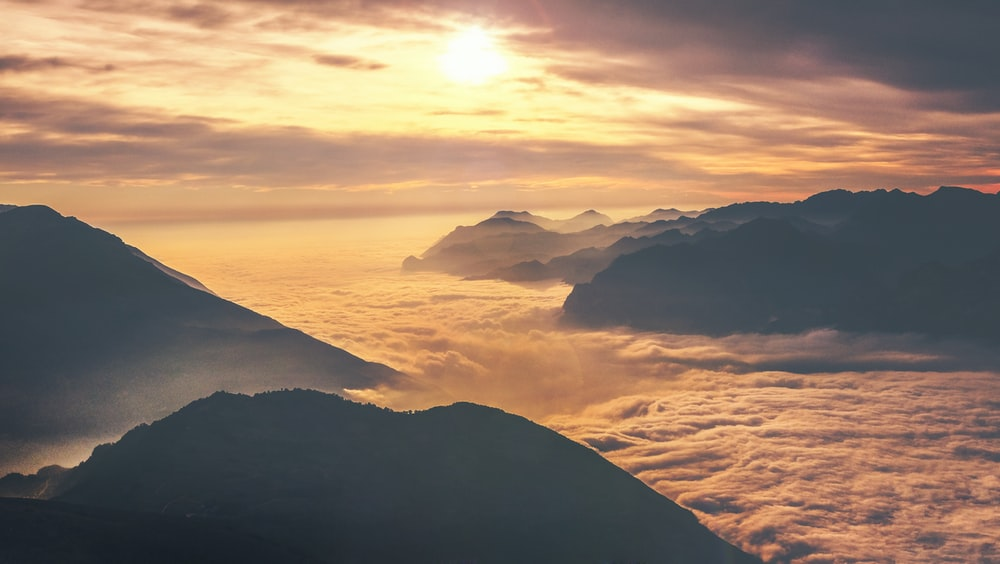 photo of mountain at sunset