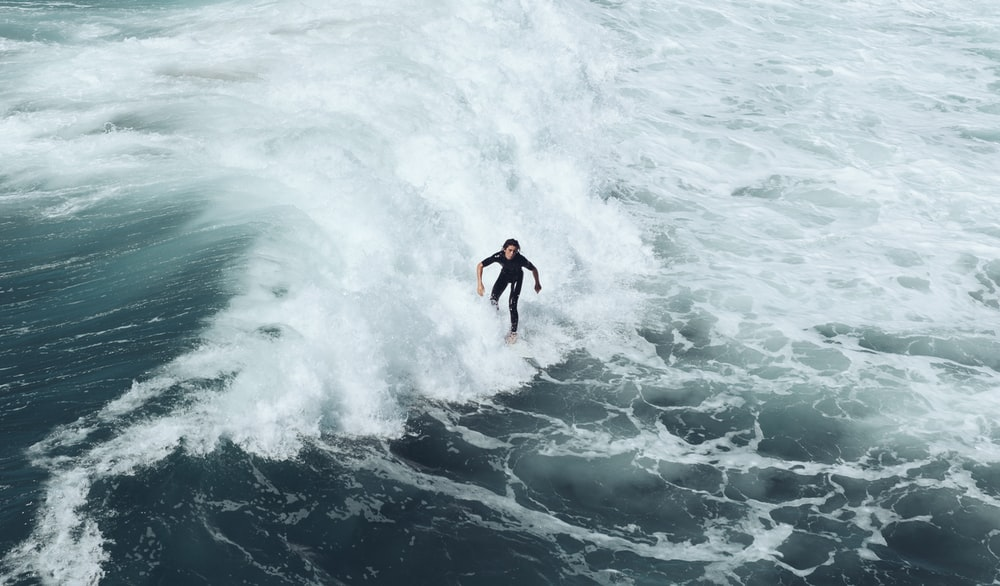 person surfing at waves