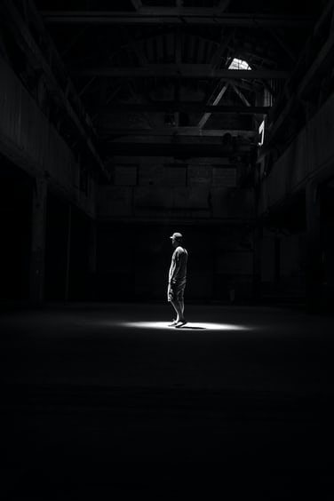 black . A dark black and white photo of a man standing in building Red Hook Black Background Pictures  Download Free Images on Unsplash