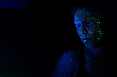 https://unsplash.com/@ic03r was inspired by some blacklight photographs he found on pinterest. We suggested that we could use the colors as sparcles to create a stunning galaxy feel. That is the outcome. We plan to do another series following real star signs on face and body.