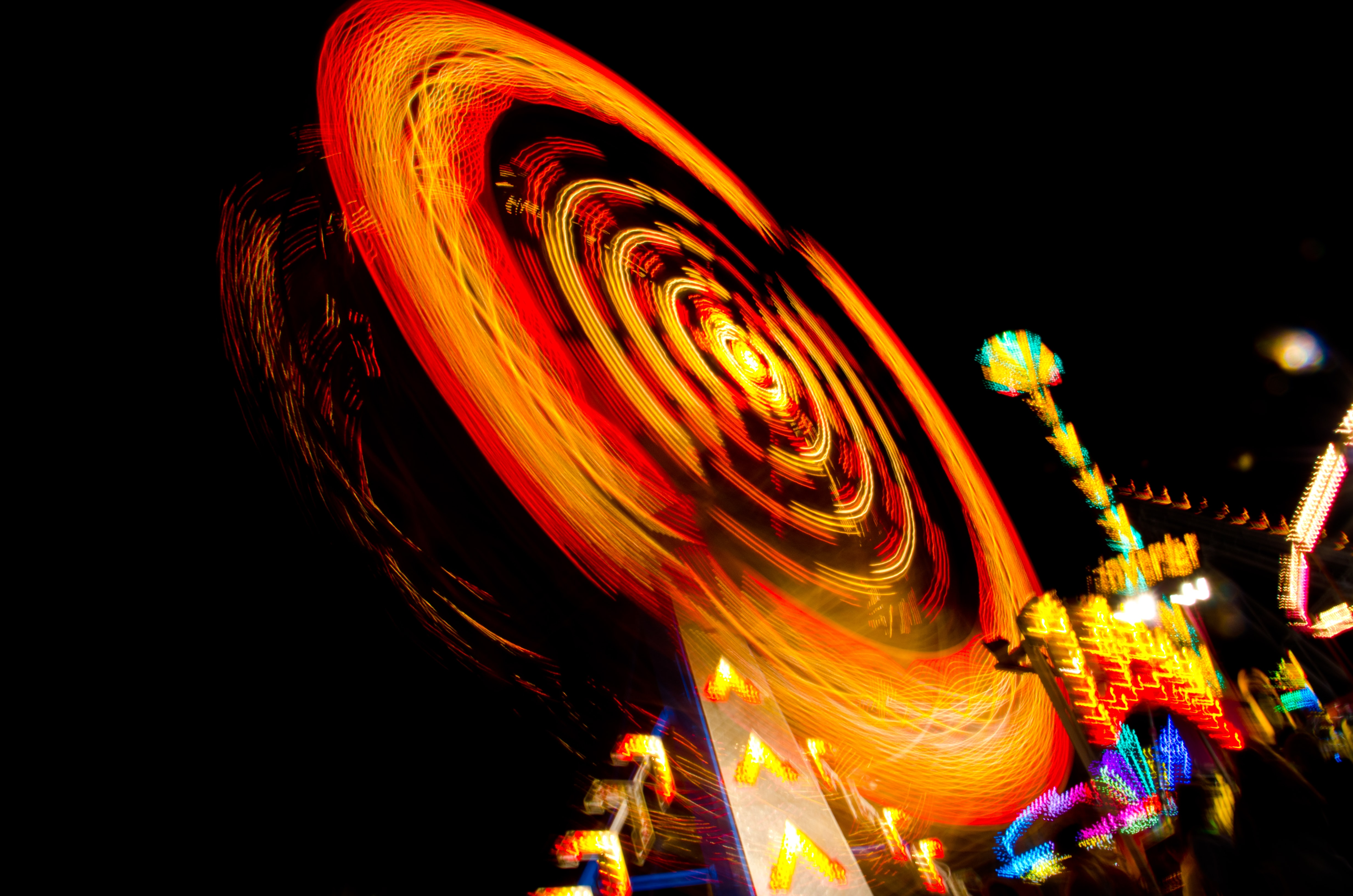 A lively shot of an illuminated ferris wheel at the fairground in Ocean City