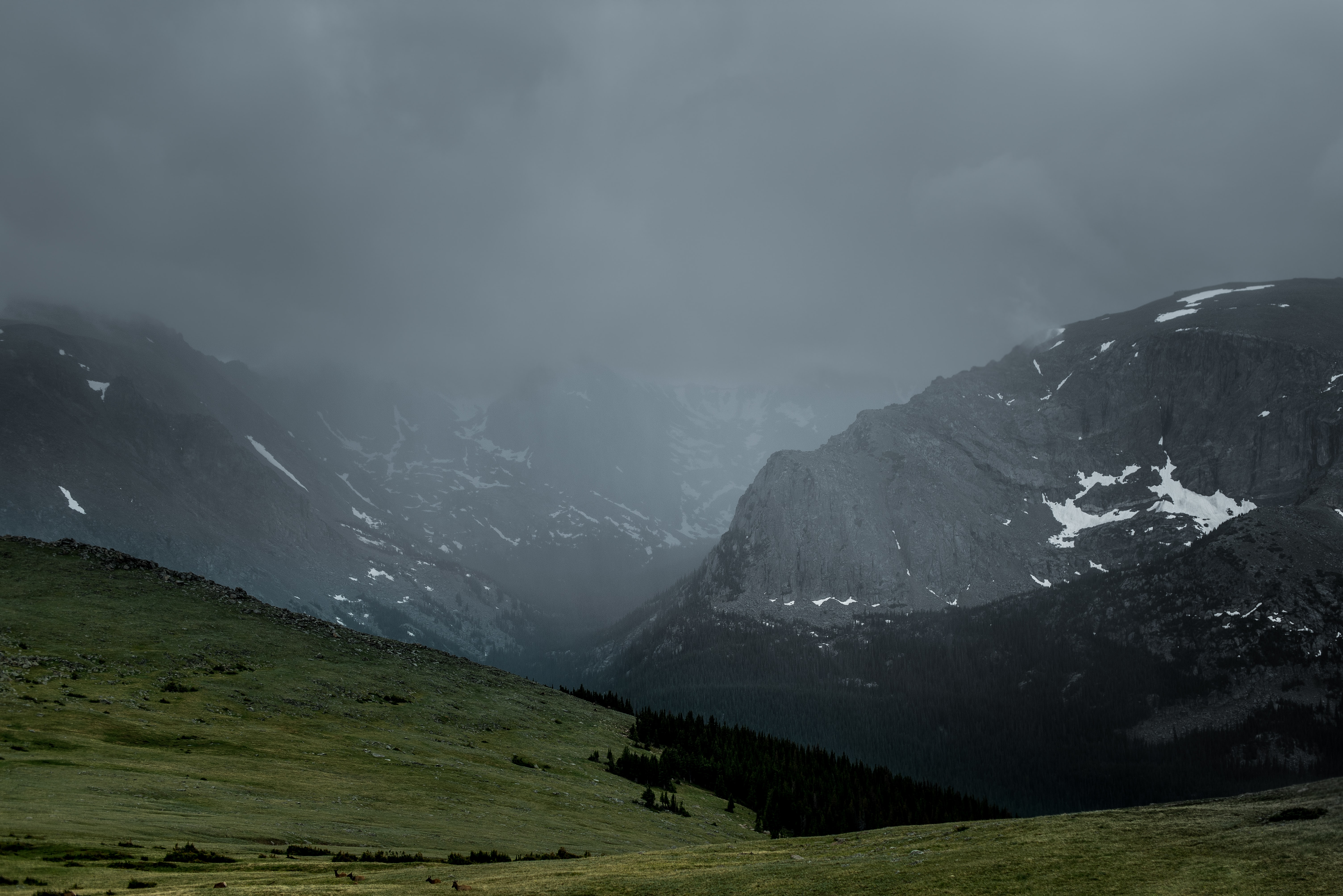 Dark clouds gathering over a mountain pass in the Rocky Mountain National Park