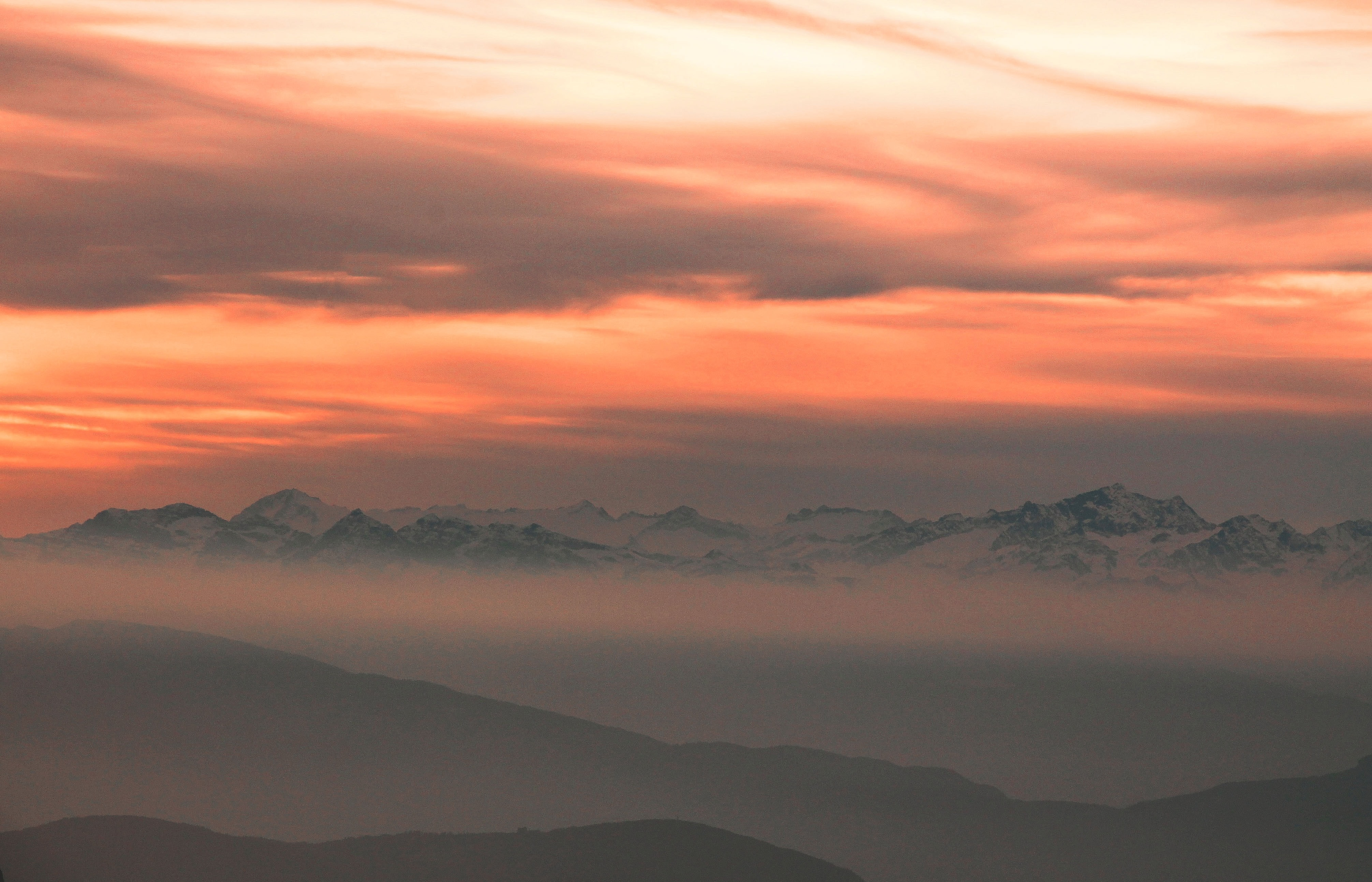 Shades of orange sunset above mountains in Ortisei